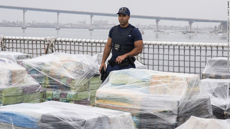 A US Coast Guard team member guards an 18-ton cocaine haul.