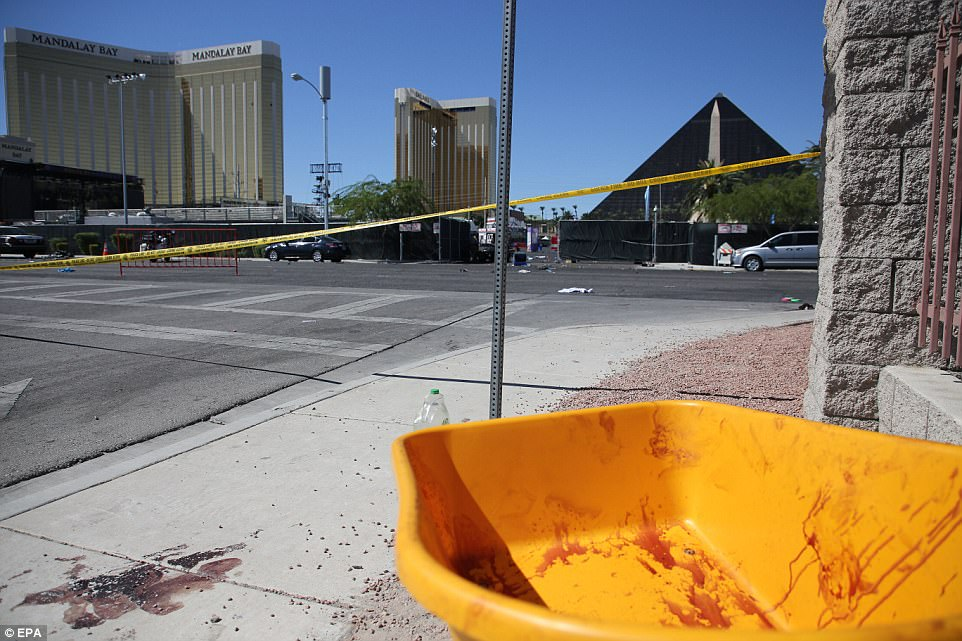 A blood-stained wheel barrow in the street in the aftermath of the mass shooting at the Route 91 Harvest festival. Police have warned that identifying bodies from the worst mass shooting in modern US history will be a 'long, laborious process'