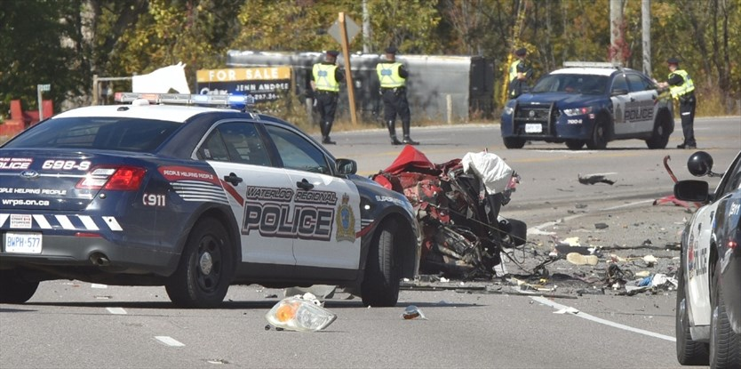 The remains of a car that struck a transport truck head on on Highway 6 Thursday morning can be seen strewn across the road. A man and a woman in the car were killed in the collision. Waterloo Regional police had tried to stop the car following an incident on King Street in Cambridge. - John Rennison,The Hamilton Spectator