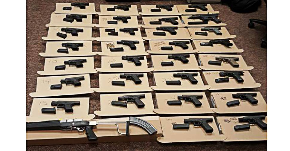 A man was charged with over 330 charges in September after Durham police seized 33 guns and other prohibited devices from a Pickering home.  Handout / Durham Regional Police Service