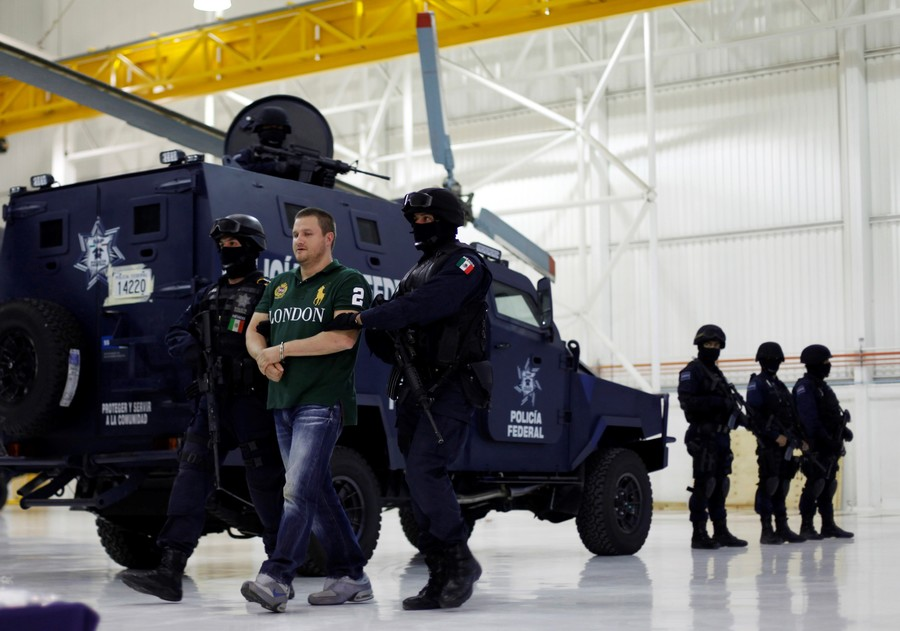 """La Barbie"" Valdez escorted by police in Mexico City in 2010. / Reuters"