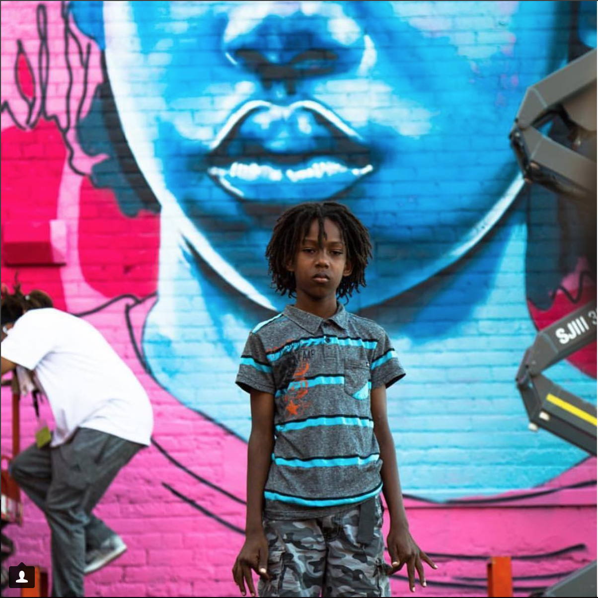 A picture from Bmike's Instagram account featuring the subject of one of his recent paintings (Evan)