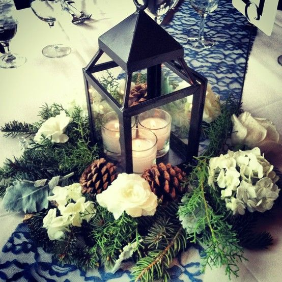 I love this classic tweak on lanterns in a wooded forest for your winter wedding.