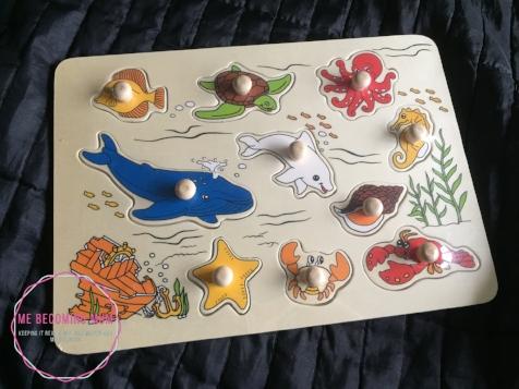 Wooden sea creature peg puzzle
