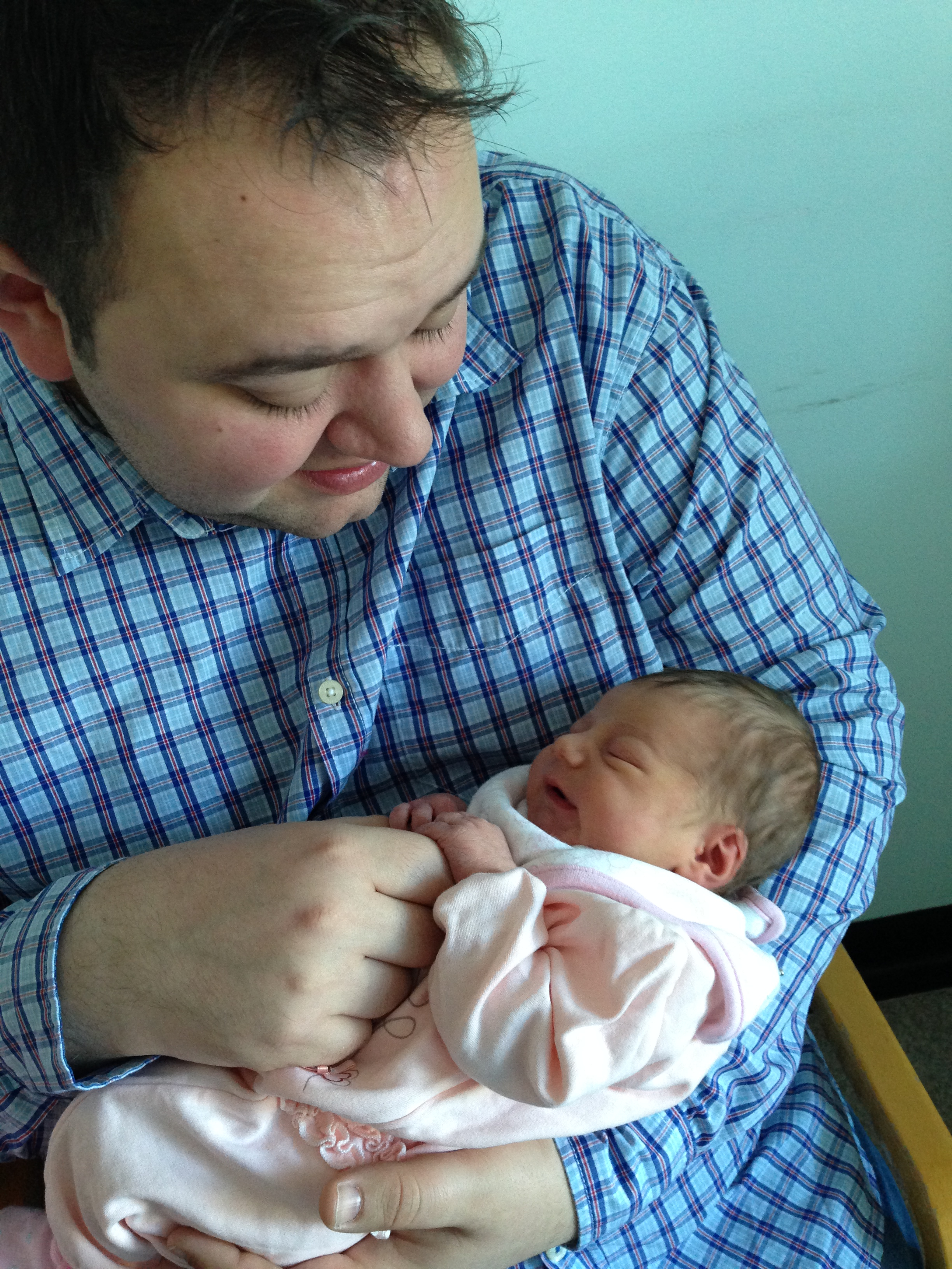 newborn baby with daddy for the first time © mebecomingmum