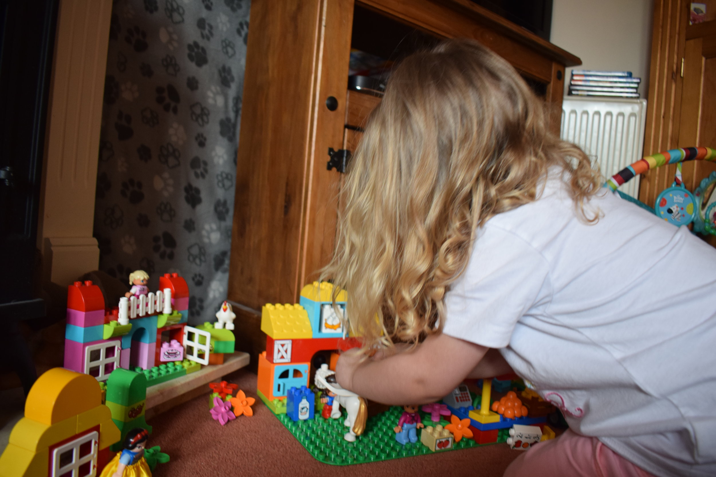 toddler playing with duplo © mebecomingmum