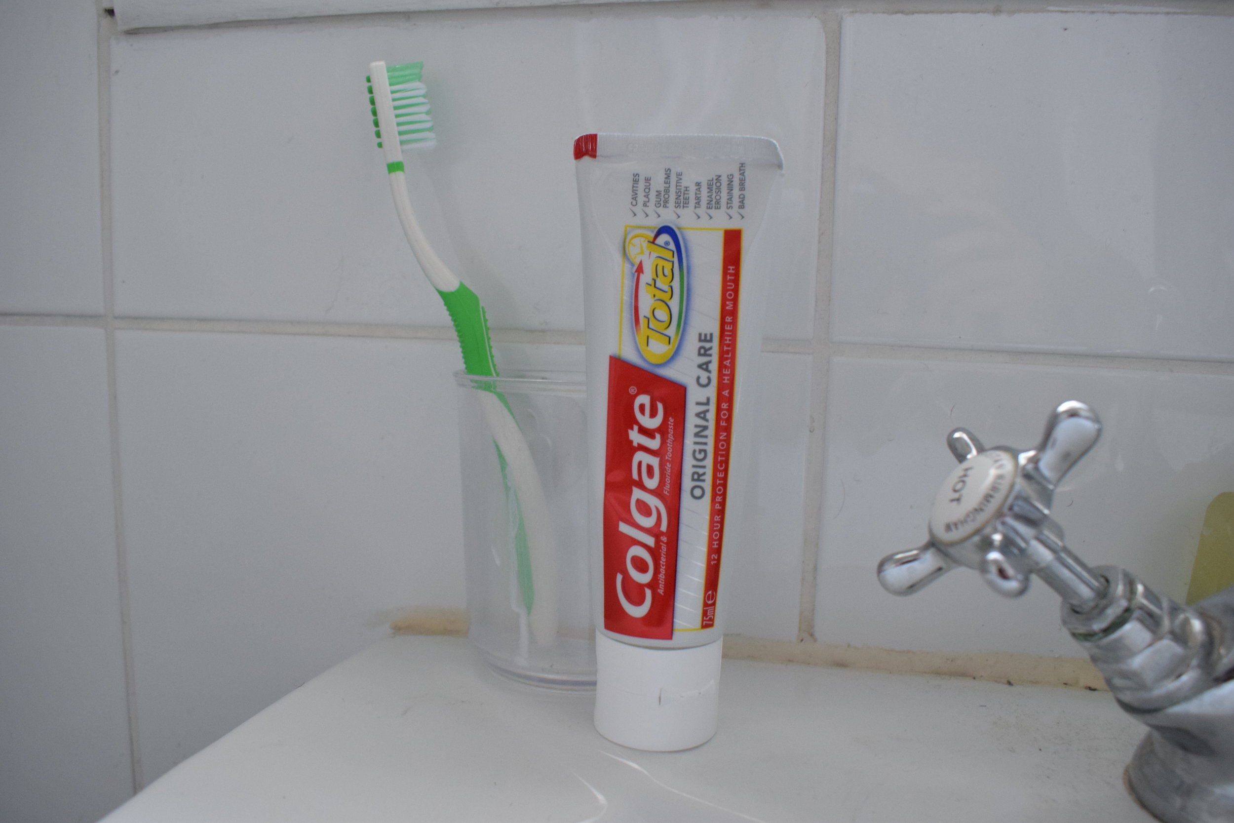 Toothbrush and Colgate Total original care toothpaste