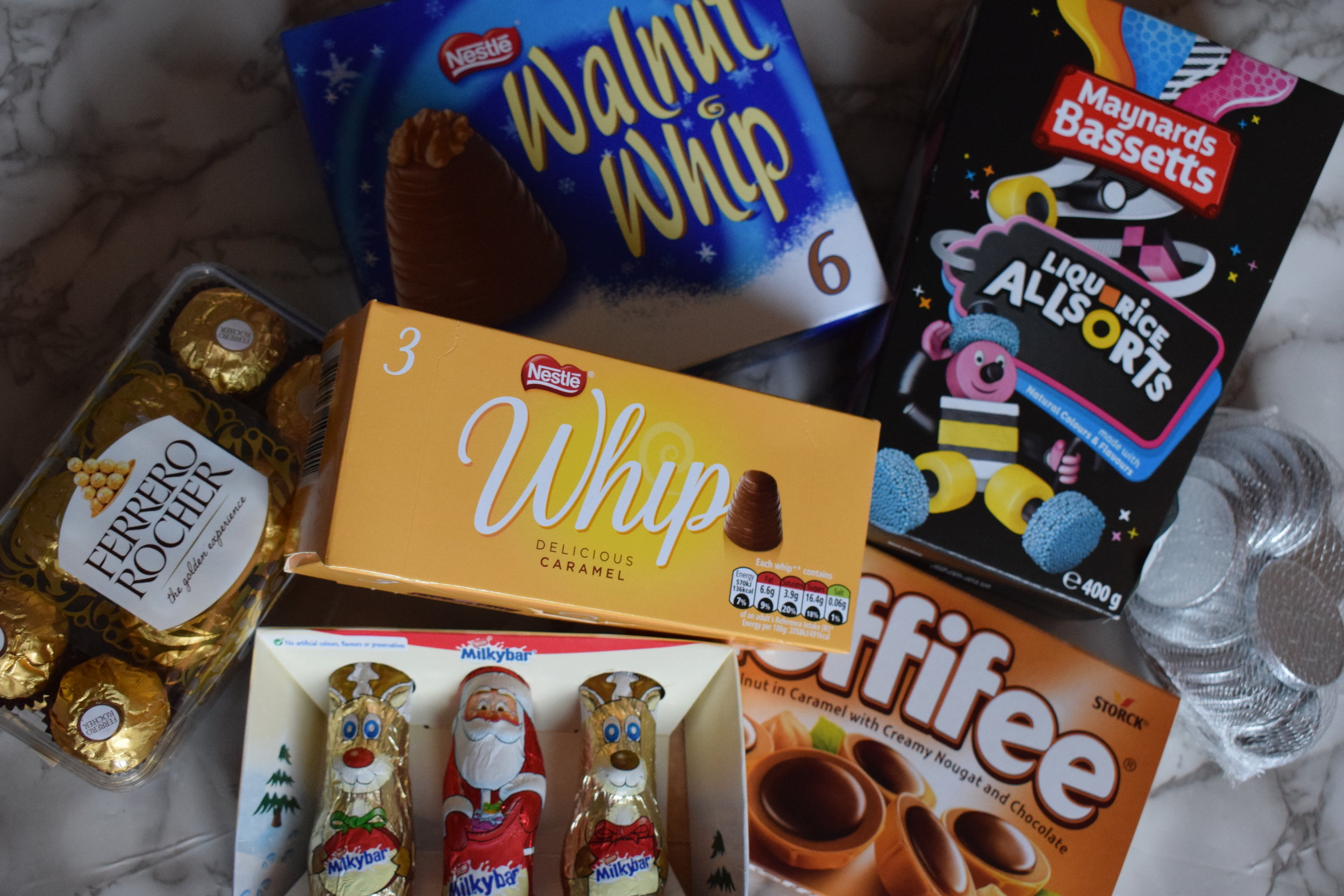 sweet treats ferrero rocher nestle walnut whip milkybar toffifee maynards bassetts liquorice allsorts white chocolate coins