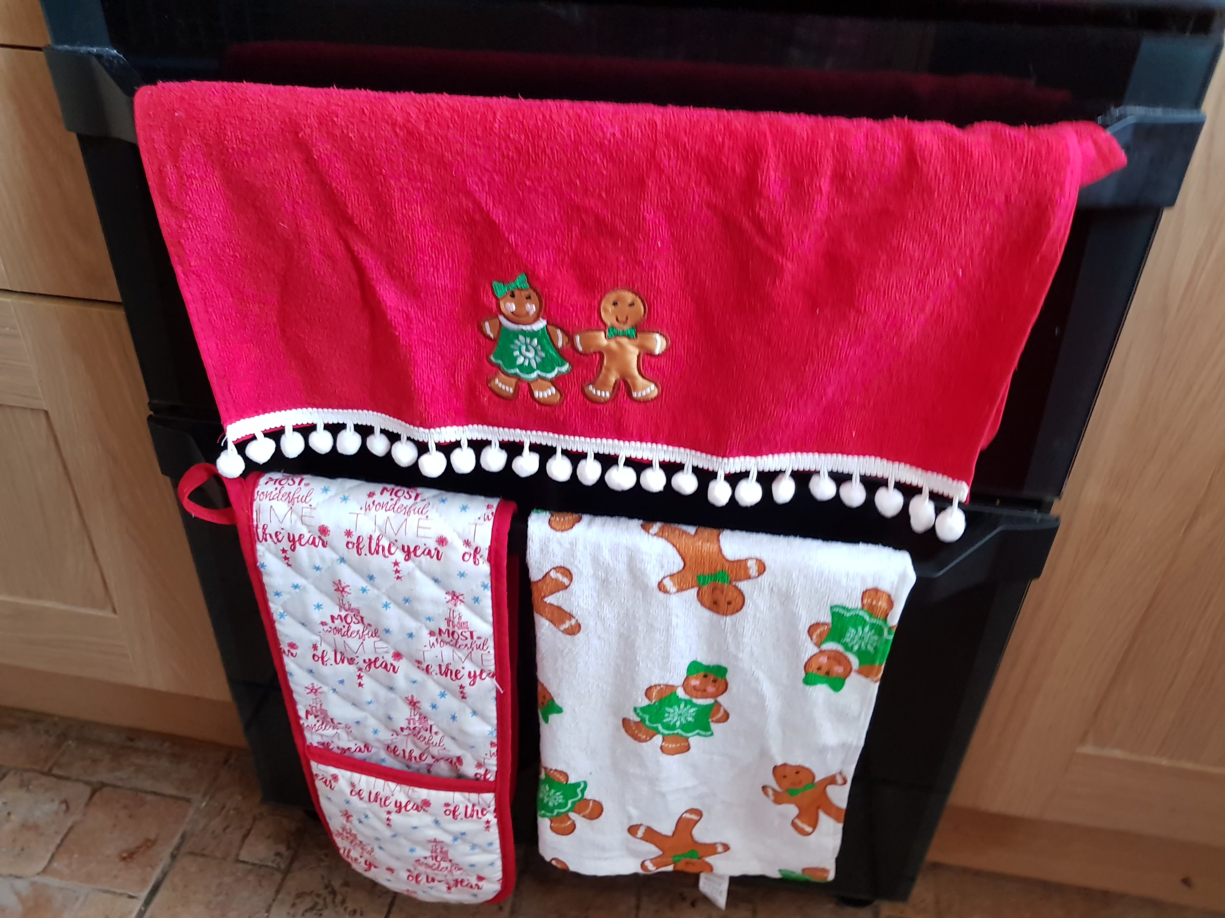 Christmas tea towels and oven gloves