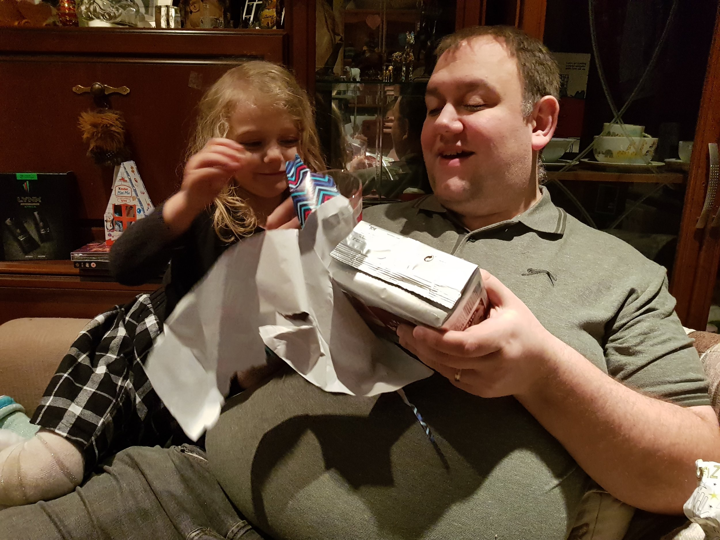 My husband opening his birthday gifts