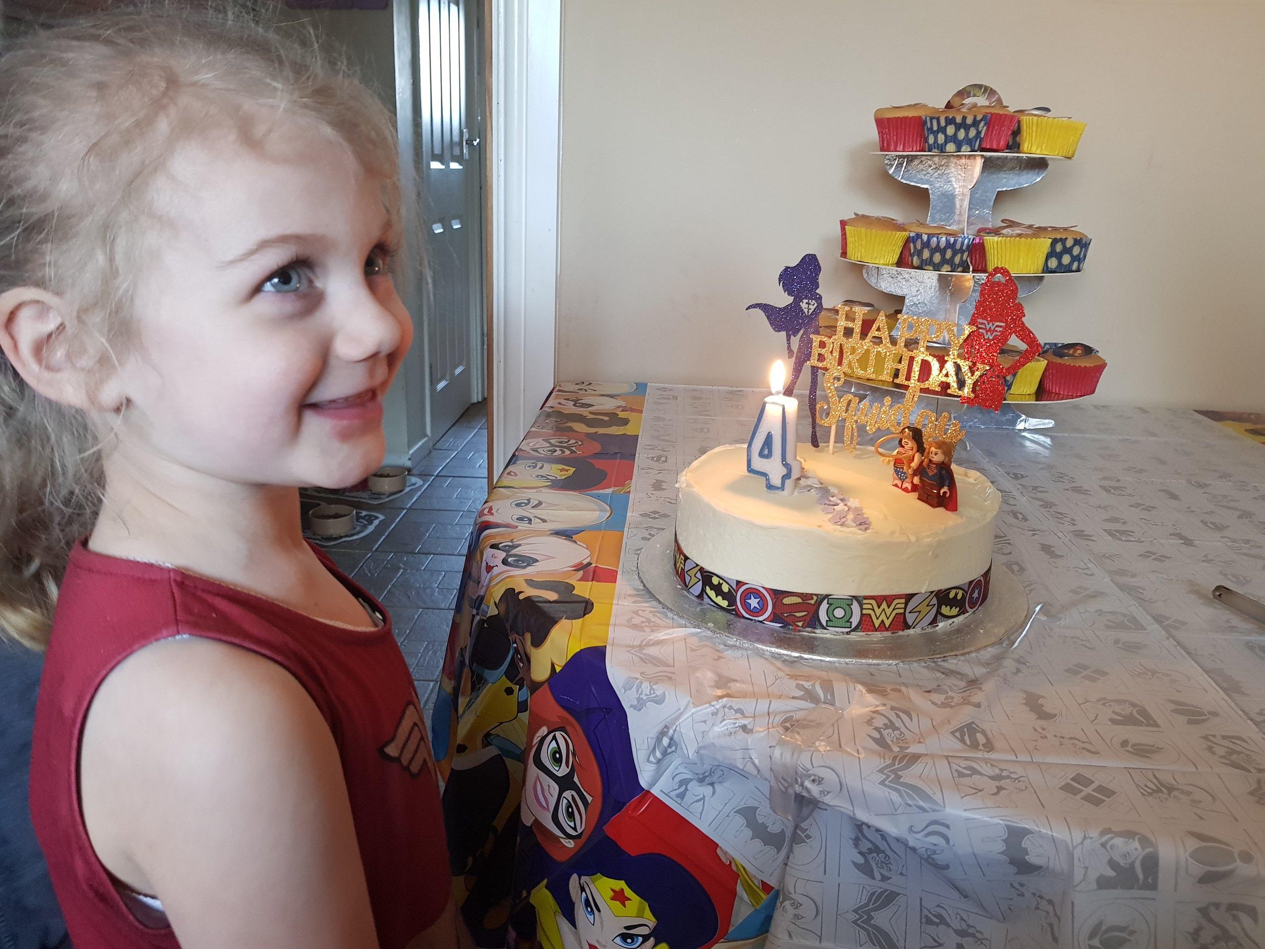Wonder Woman Supergirl birthday cake moments