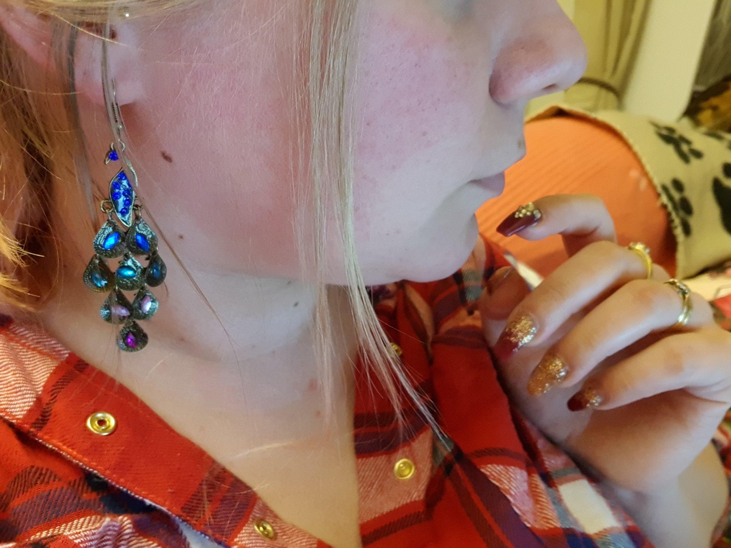 "The Jewel Genie ""Imperfect Beauty"" peacock earrings"