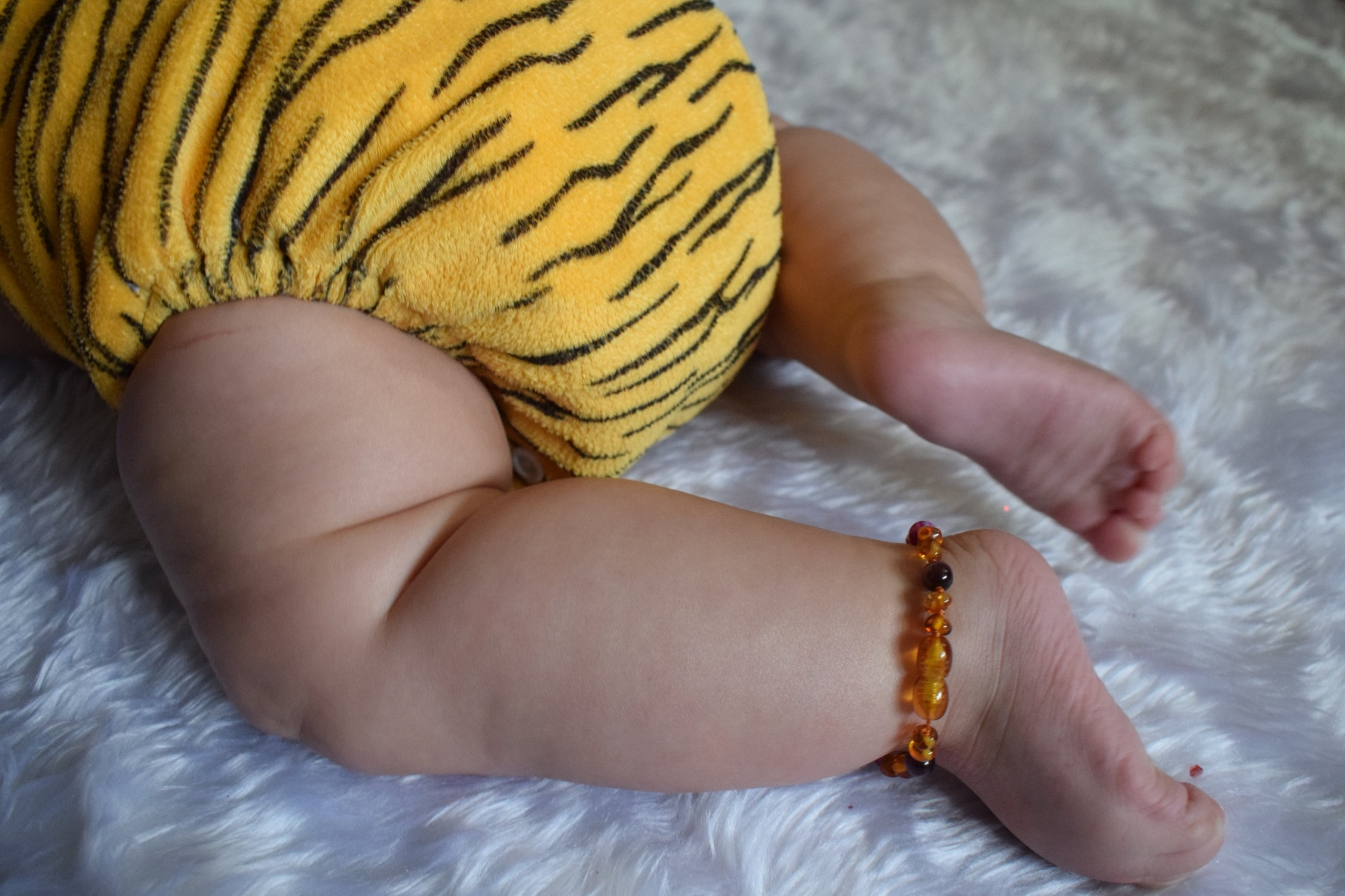 Cloth nappy and amber teething anklet
