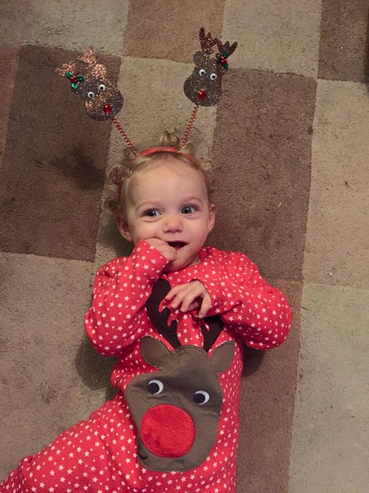 baby's first Christmas dressed as a reindeer