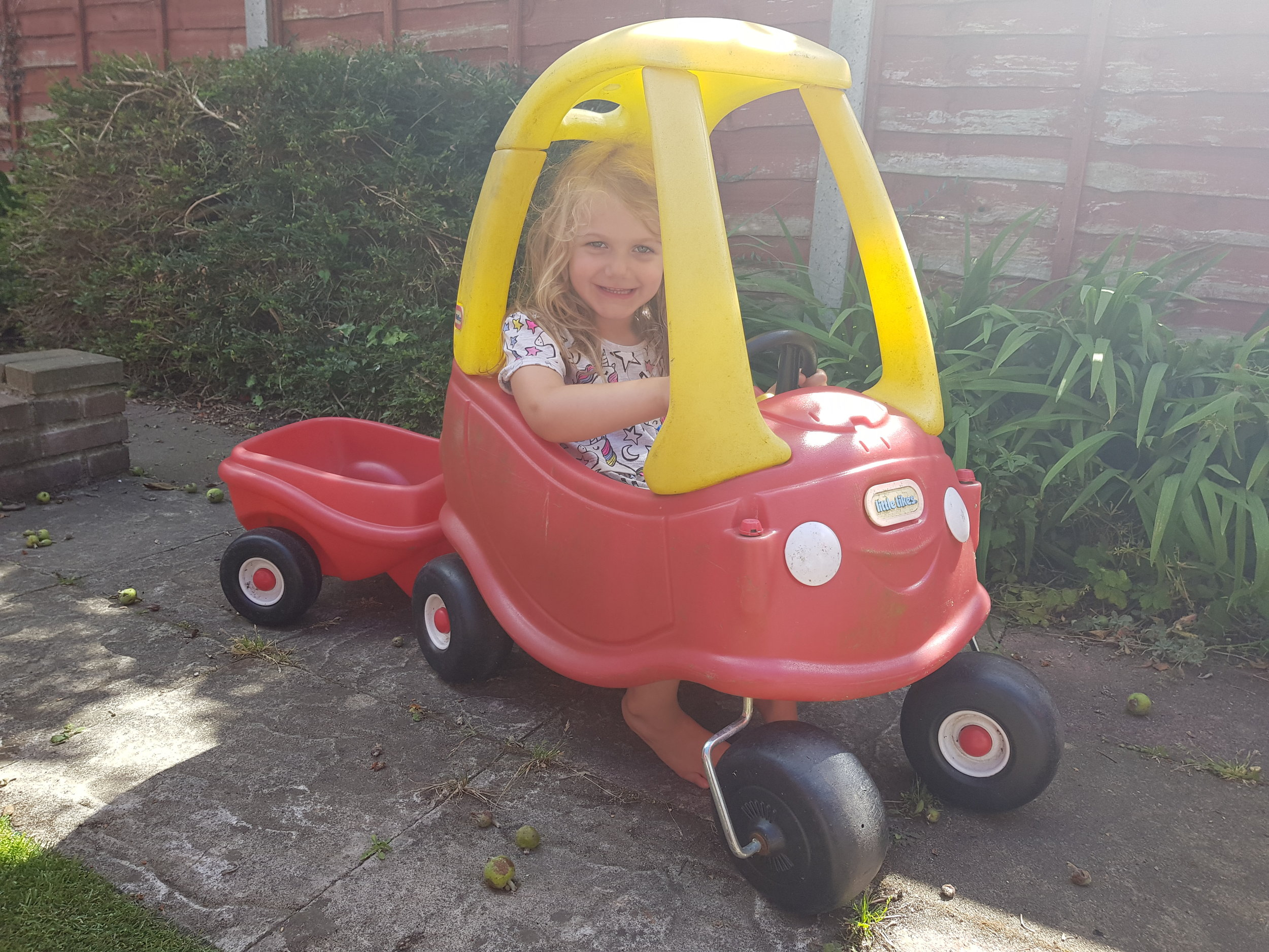 Little Tikes toy car and trailer in the garden
