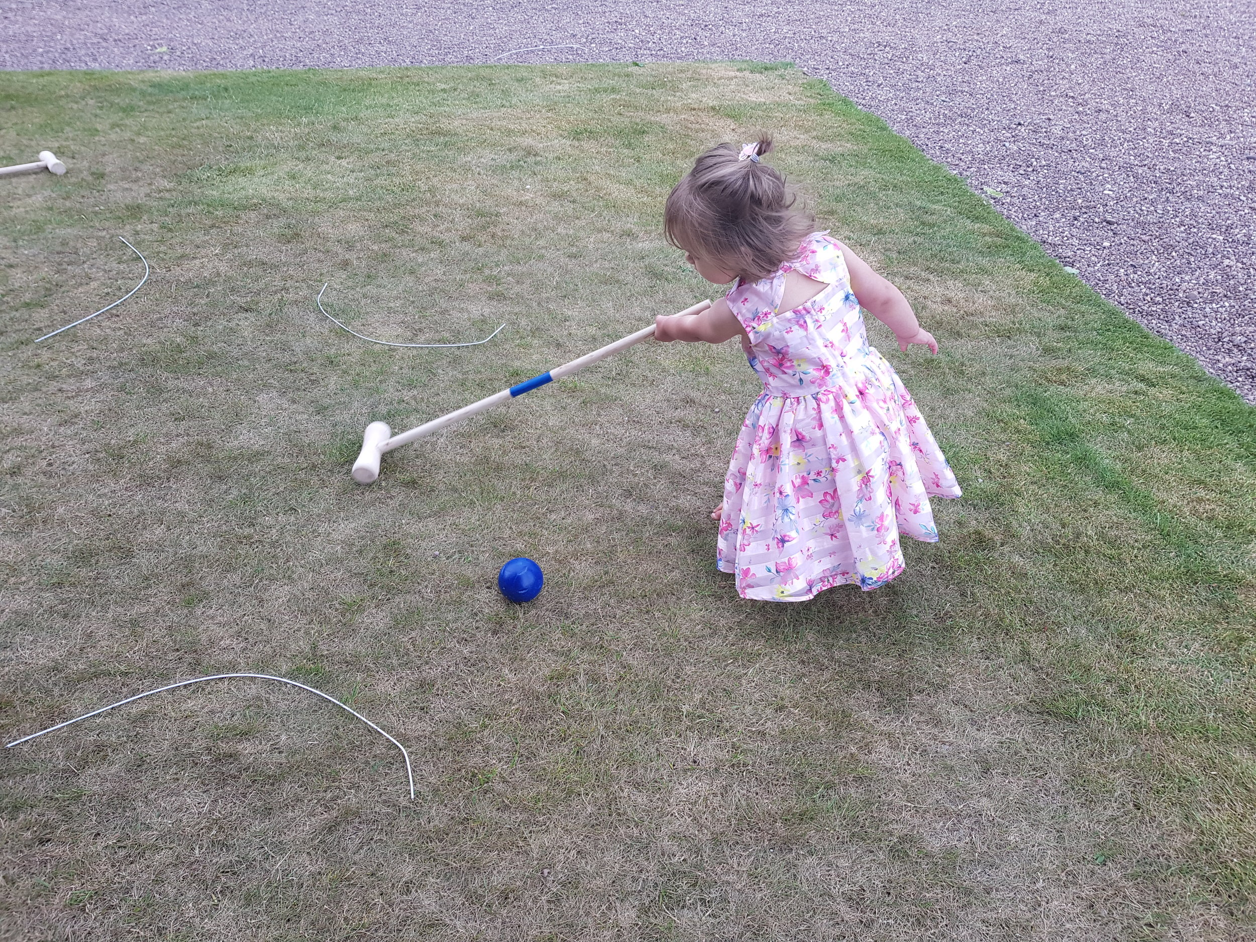 Playing croquet at the wedding
