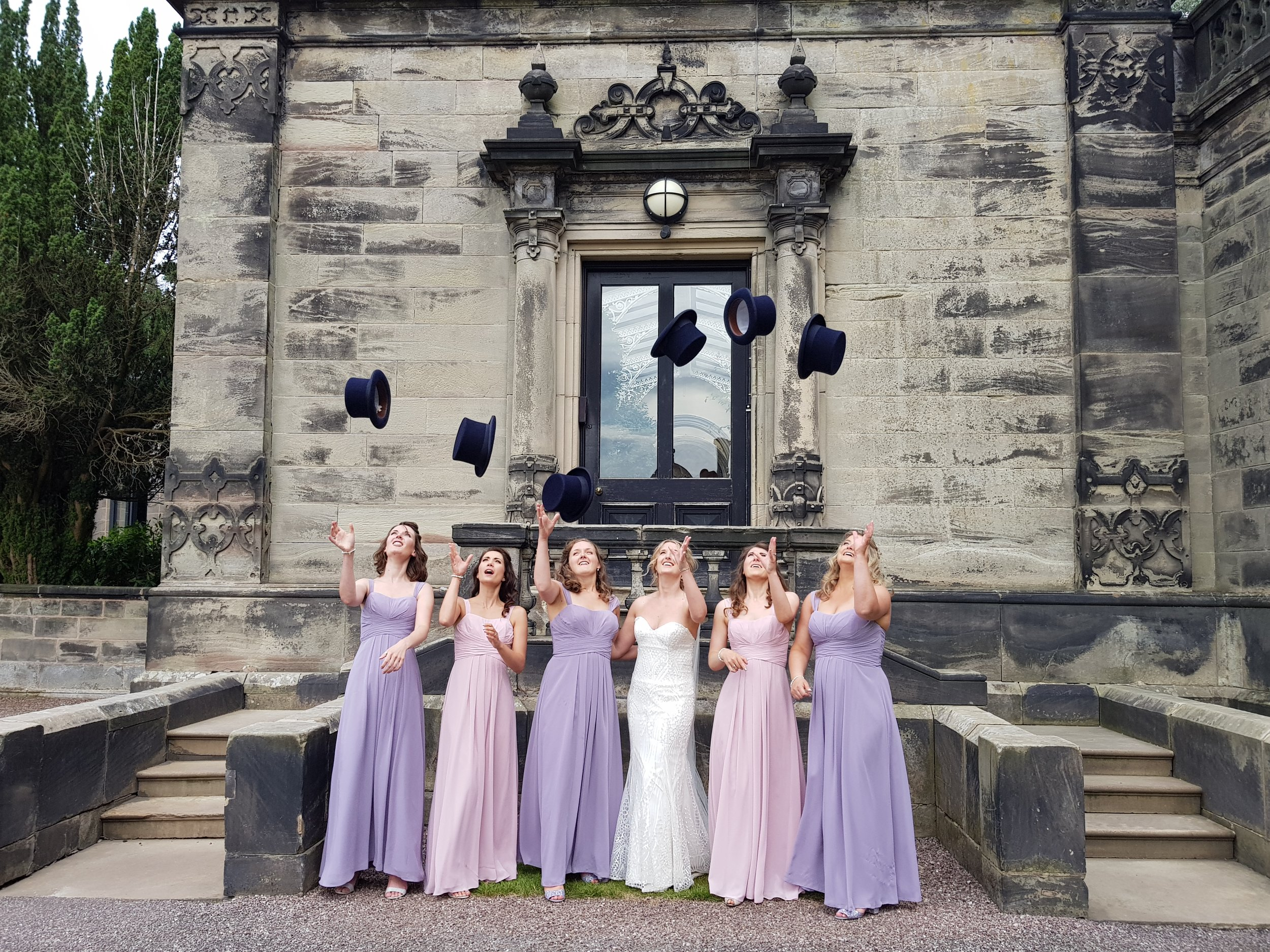 Wedding photo ideas: top hat toss by the bride and bridesmaids
