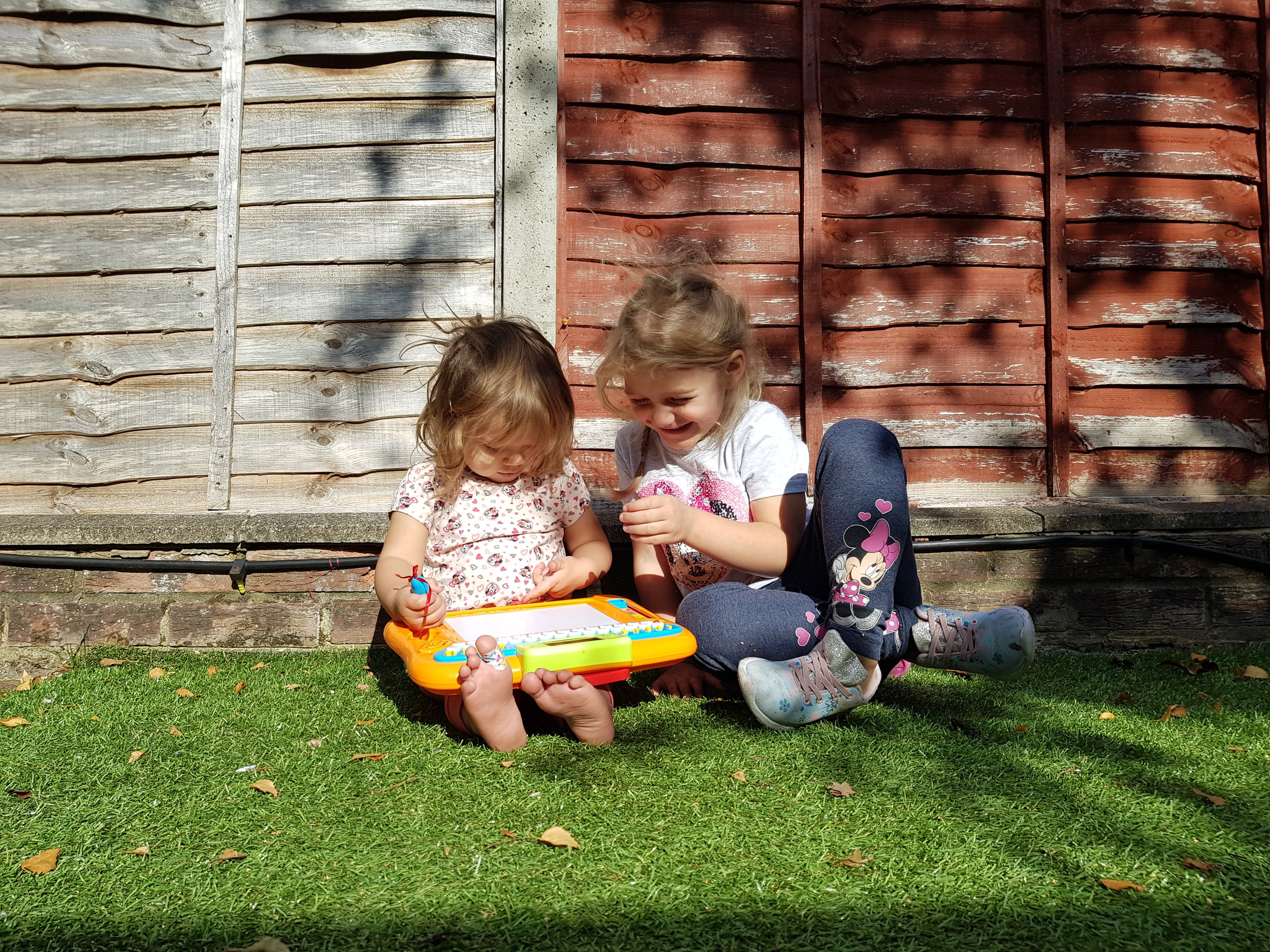 Playing in the garden with their new toy