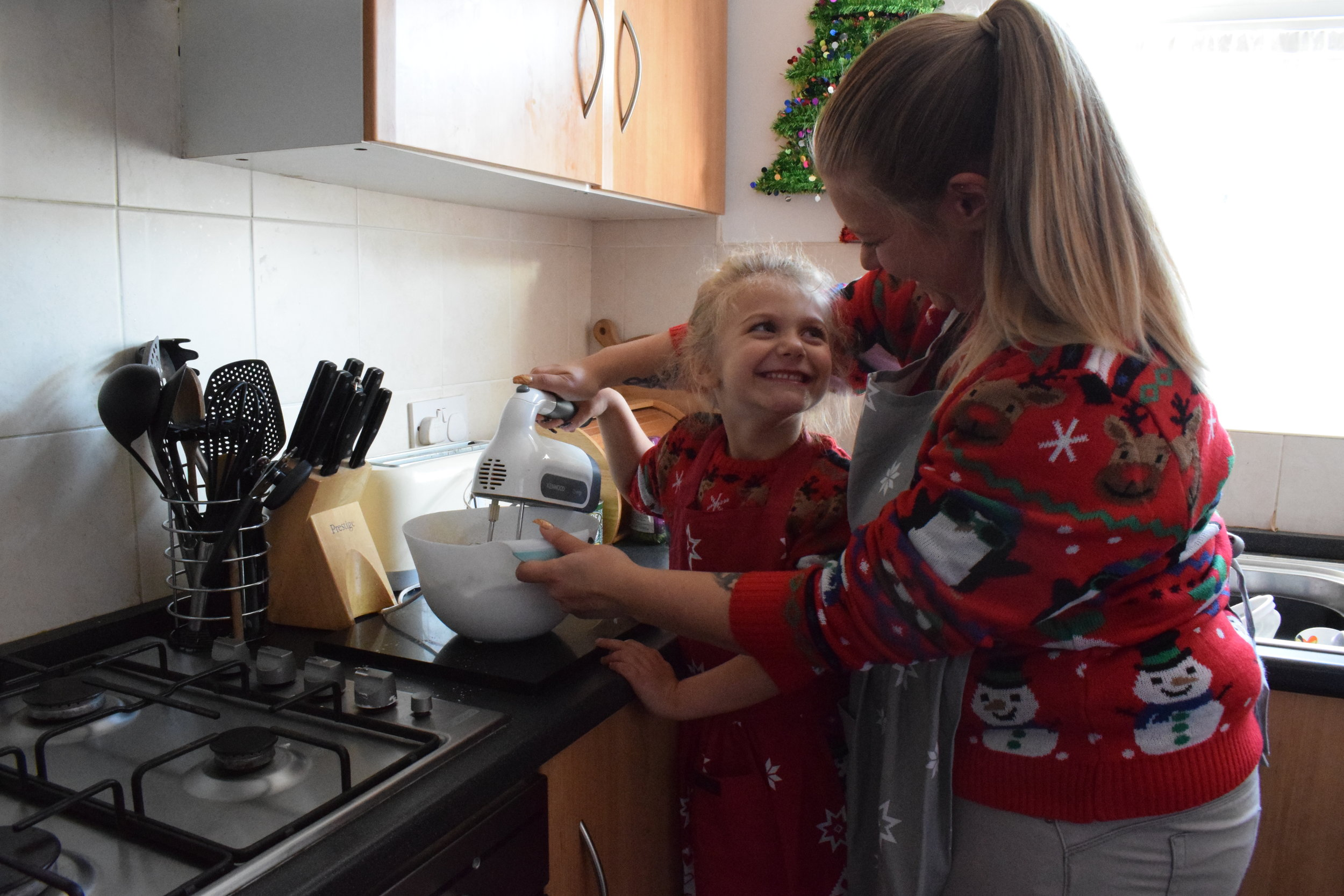 Christmas baking fun mum and daughter moment
