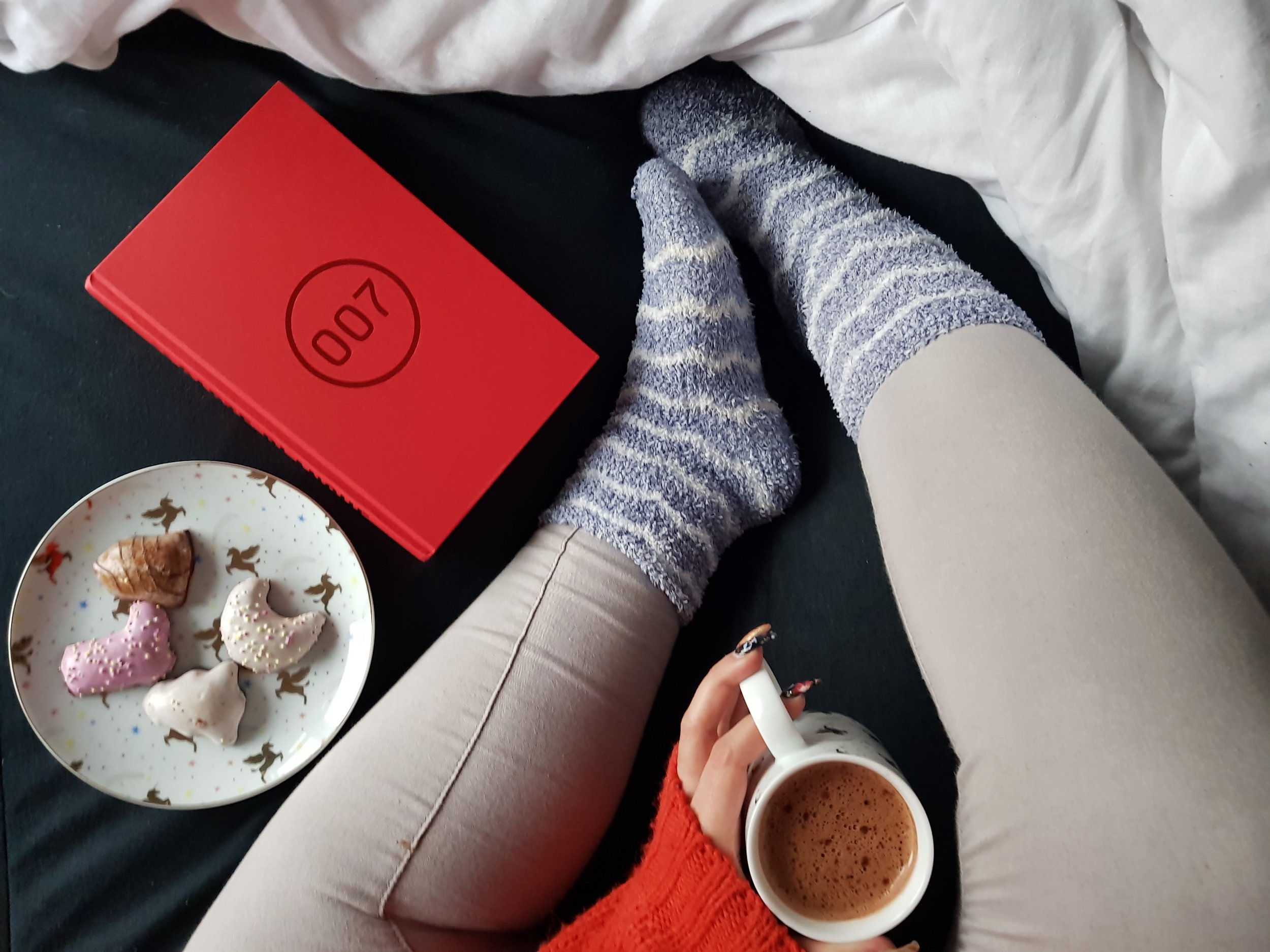 Relax and unwind with a book, drink and biscuits