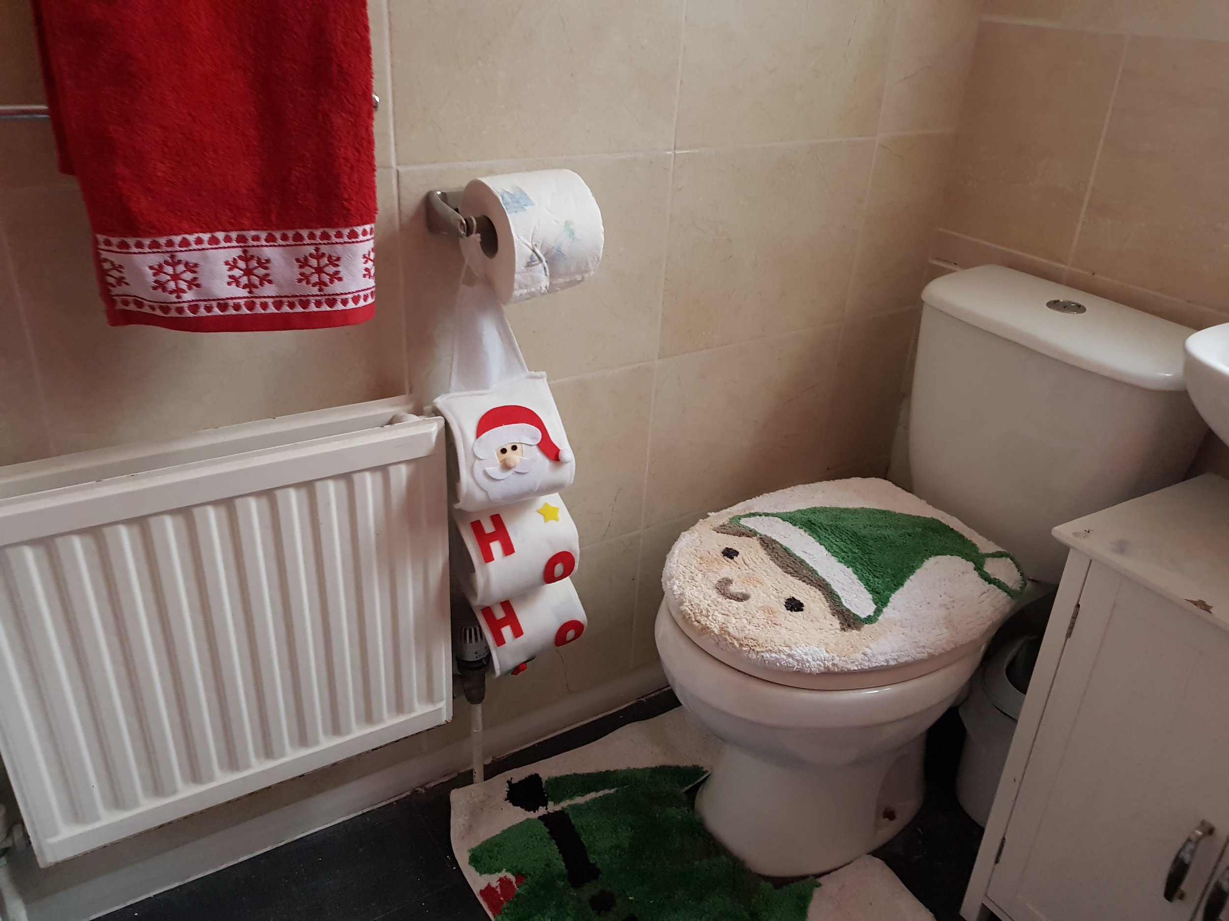 Christmas toilet cover, toilet rolls and towels