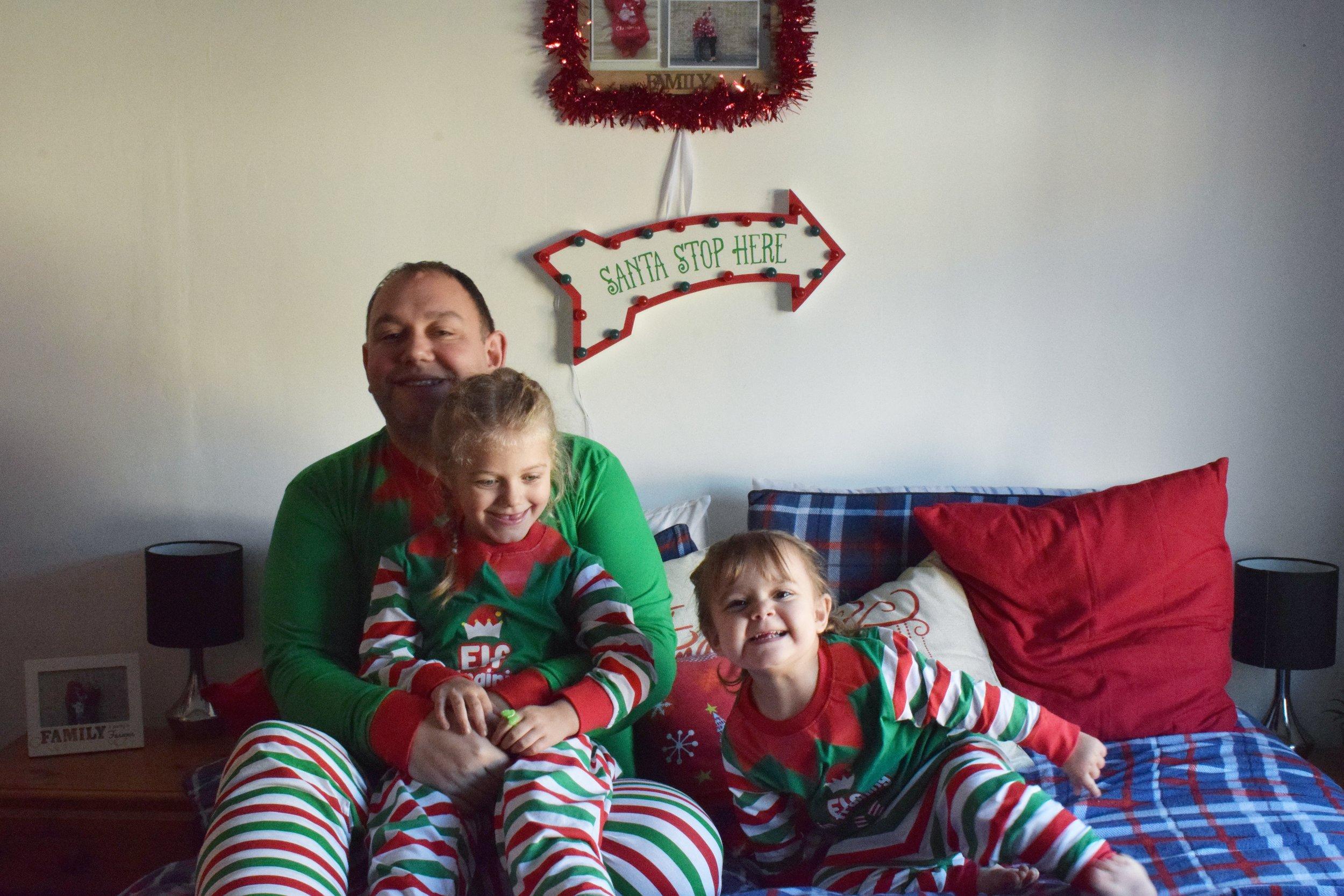 Matching family Christmas elf pyjamas from The Pyjama Factory