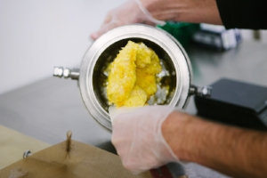 this is not a helper in my lab, this is a stock photo of some hunky guy making a nice wax and oil mash up. .