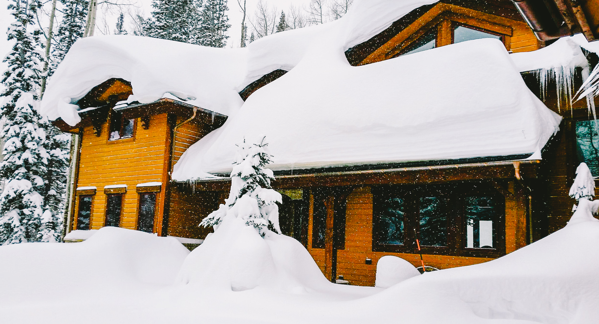 Snow Piling up on a Park City Homeowner's Roof.