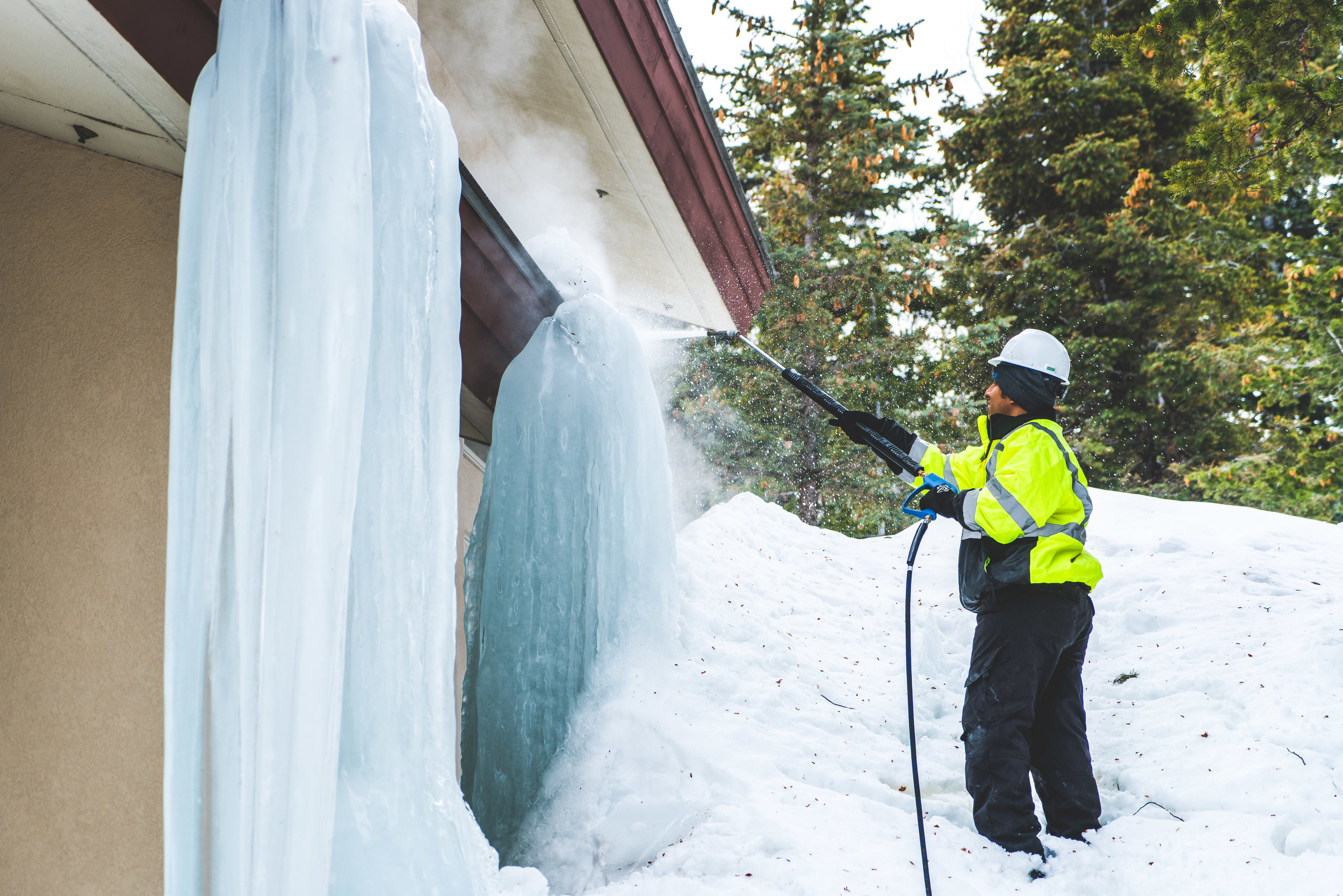 An Ice Dam Being Removed Off Of A Deer Valley Home.