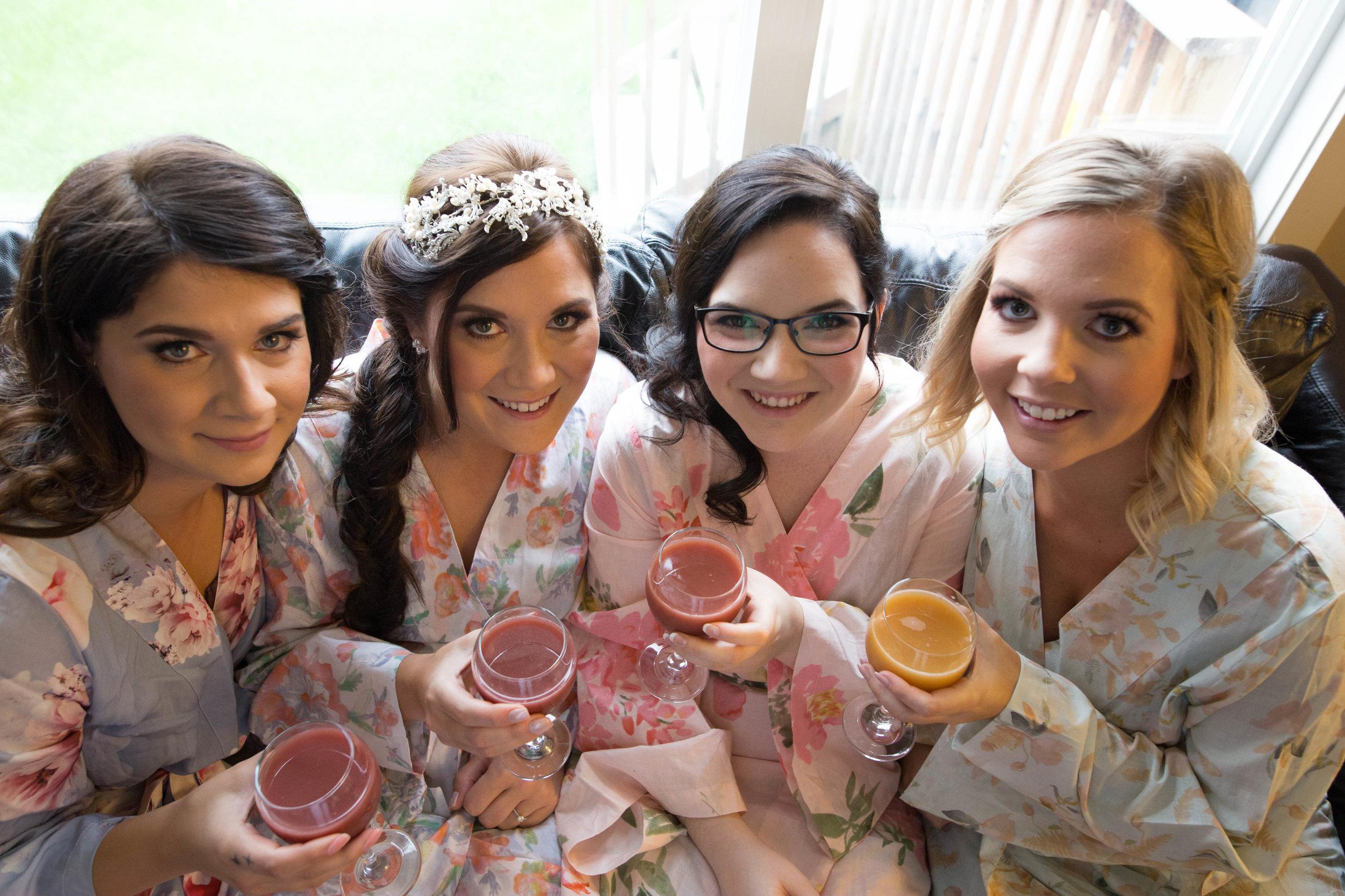 Bridesmaids drinking mimosas