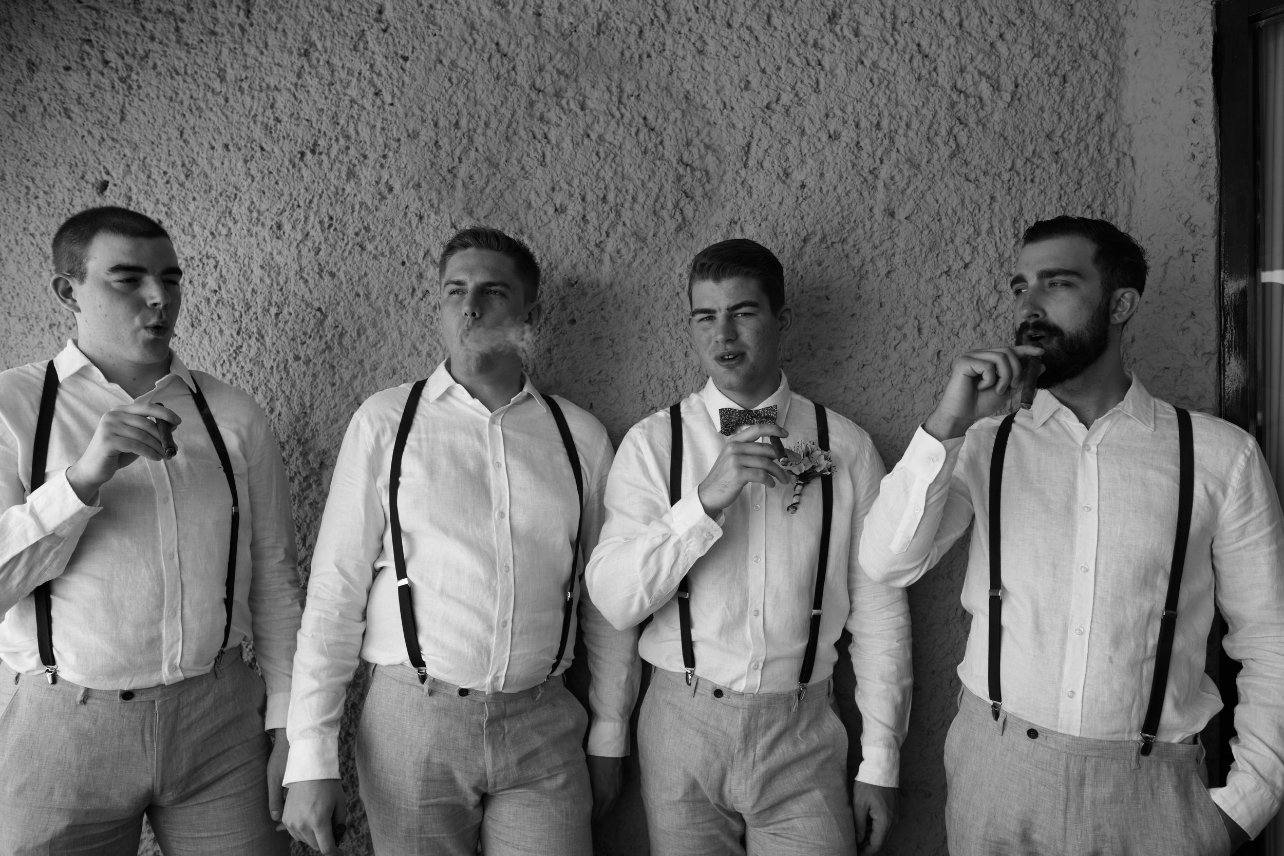 Groomsmen smoking cigars. Hotel Hutatulco Mexico