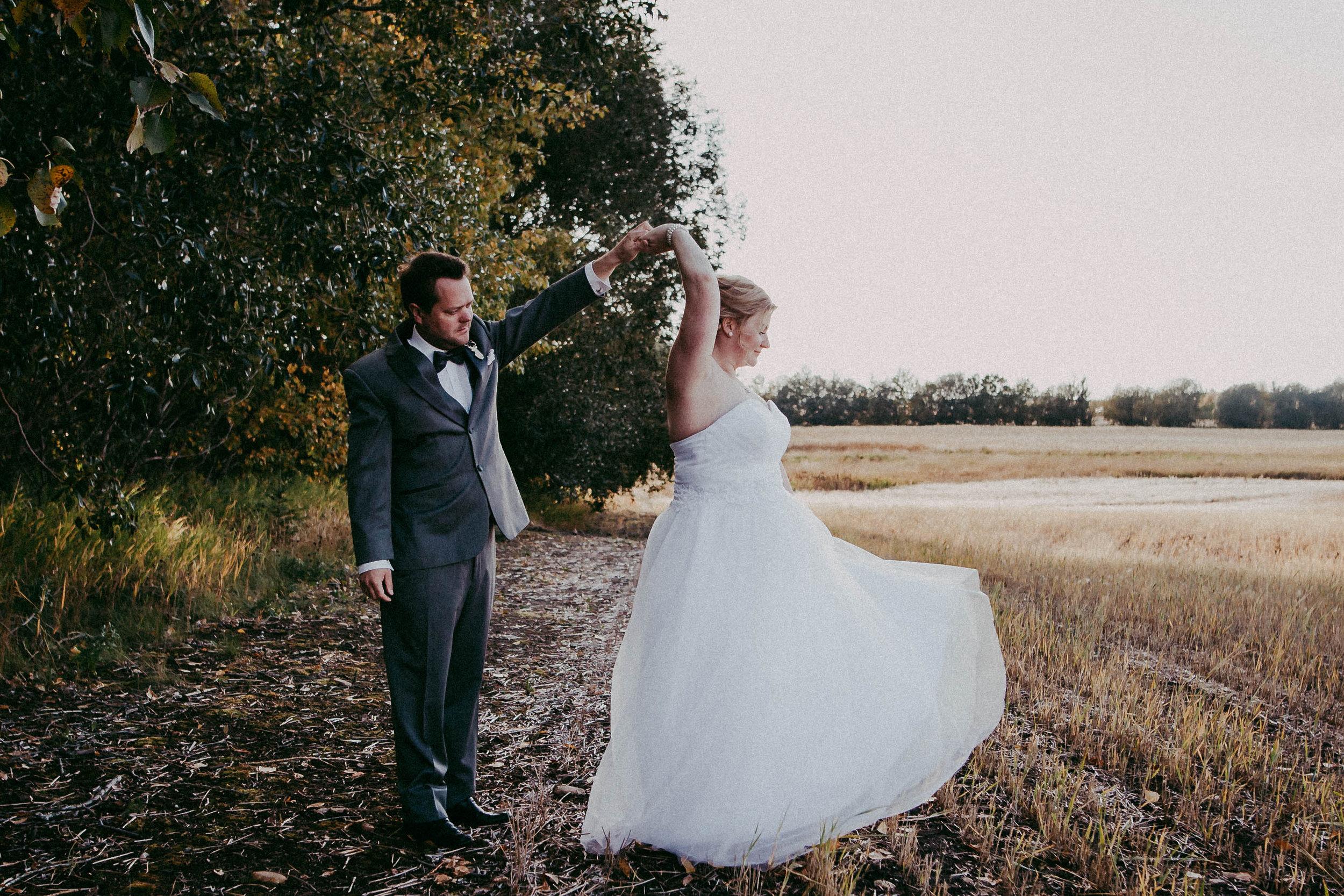 Groom dancing with bride | edmonton photographer