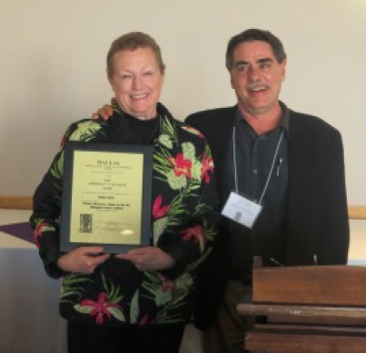 Maria Roof receiving the Whitaker Prize from President Michael Schroeder at Ithaca College, MACLAS 2015.