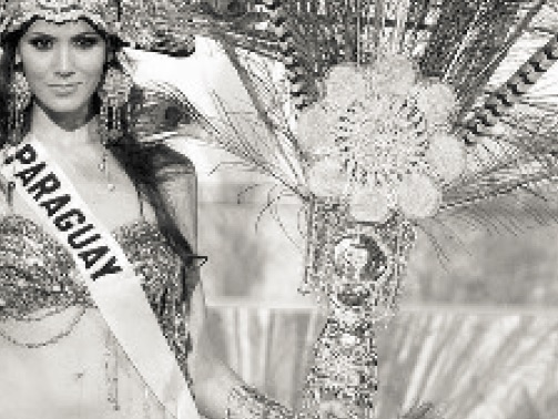 "From Christina Turner, ""Textile Tradition and National Identity"".  Caption:  ""Figure 3.  Miss Paraguay competing for Miss Universe in 2006 in her 'national costume' that utilizes    ñandutí   in the fan as part of the design motif. Needless to say, this is not a costume you would be likely to actually see in Paraguay!"""