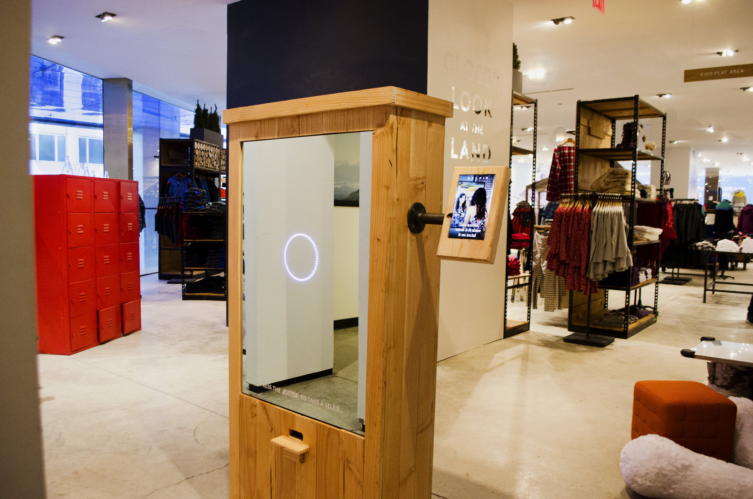 SELFIE mirror built and deployed in the Lands End Pop-Up in NYC. After a photo was taken a coupon was dispensed for discounts in store.