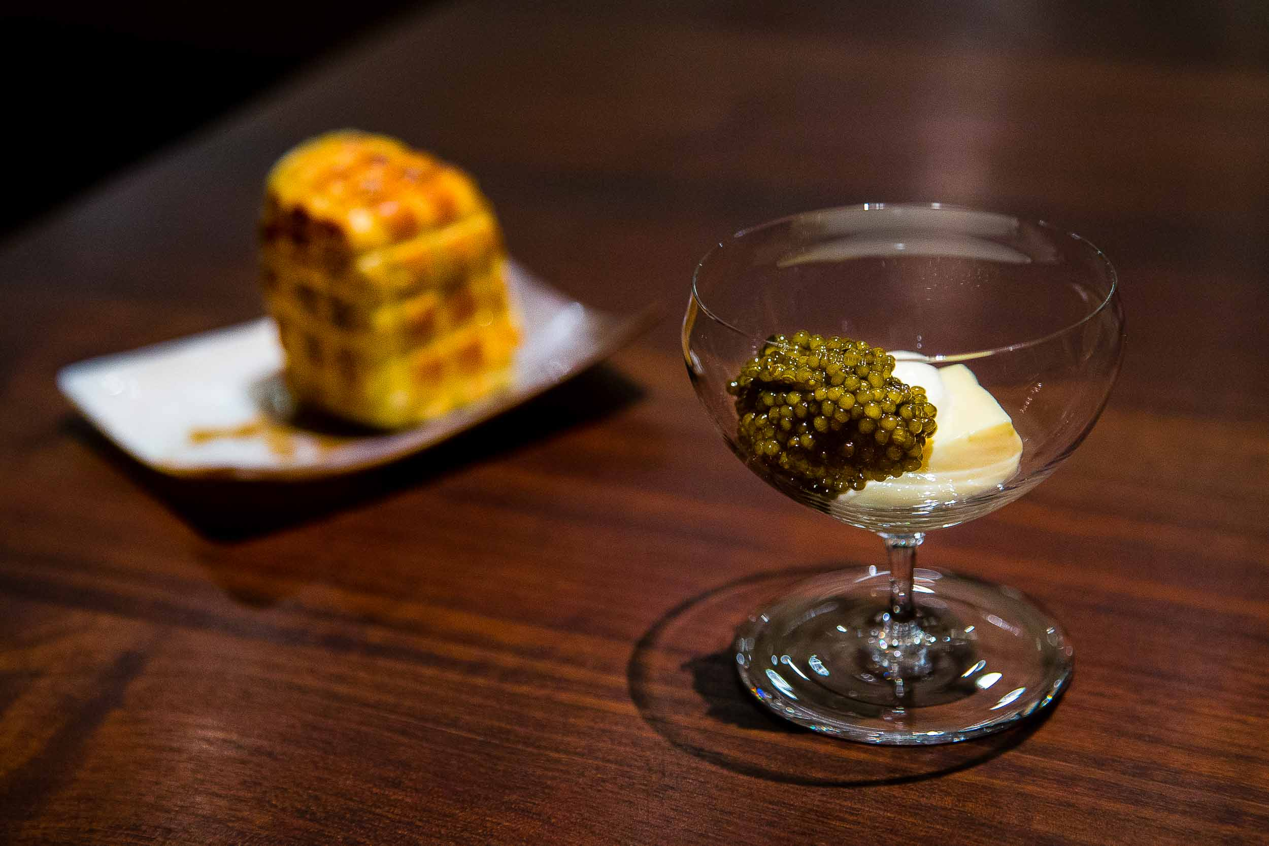 Egg custard, red hock cheese, and golden Osetra caviar with a Parker House roll brushed in olive oil and grilled over the fire.