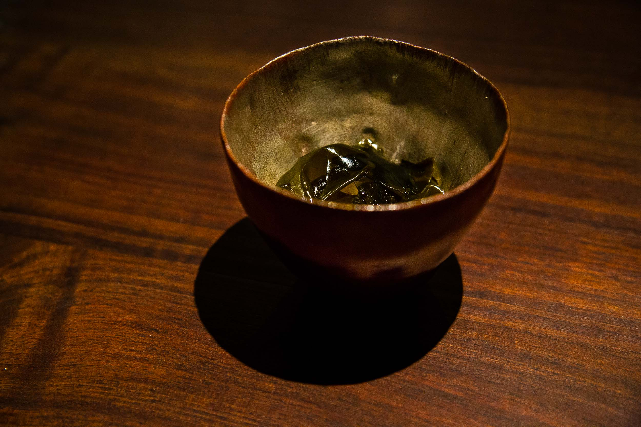 Monterey Bay abalone, seaweed, and rice with sauce made of abalone liver and capers.