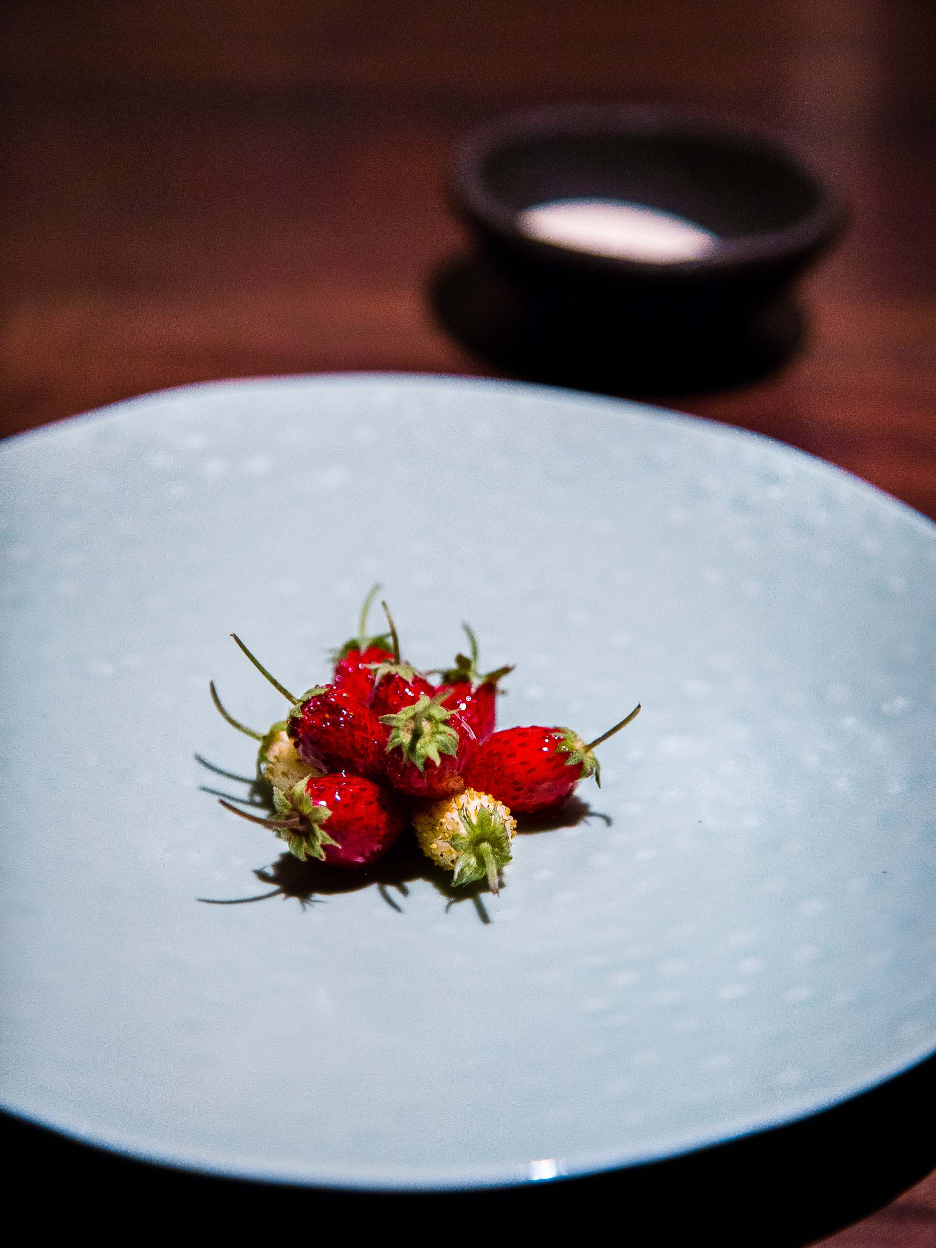 Strawberries dipped in their own juices and served with cream.