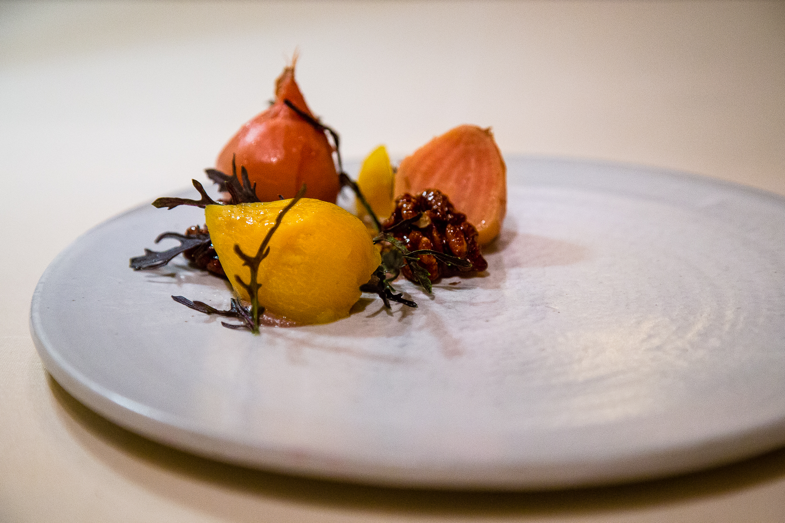 Pickled Beets with Candied Walnuts and Mustard Greens