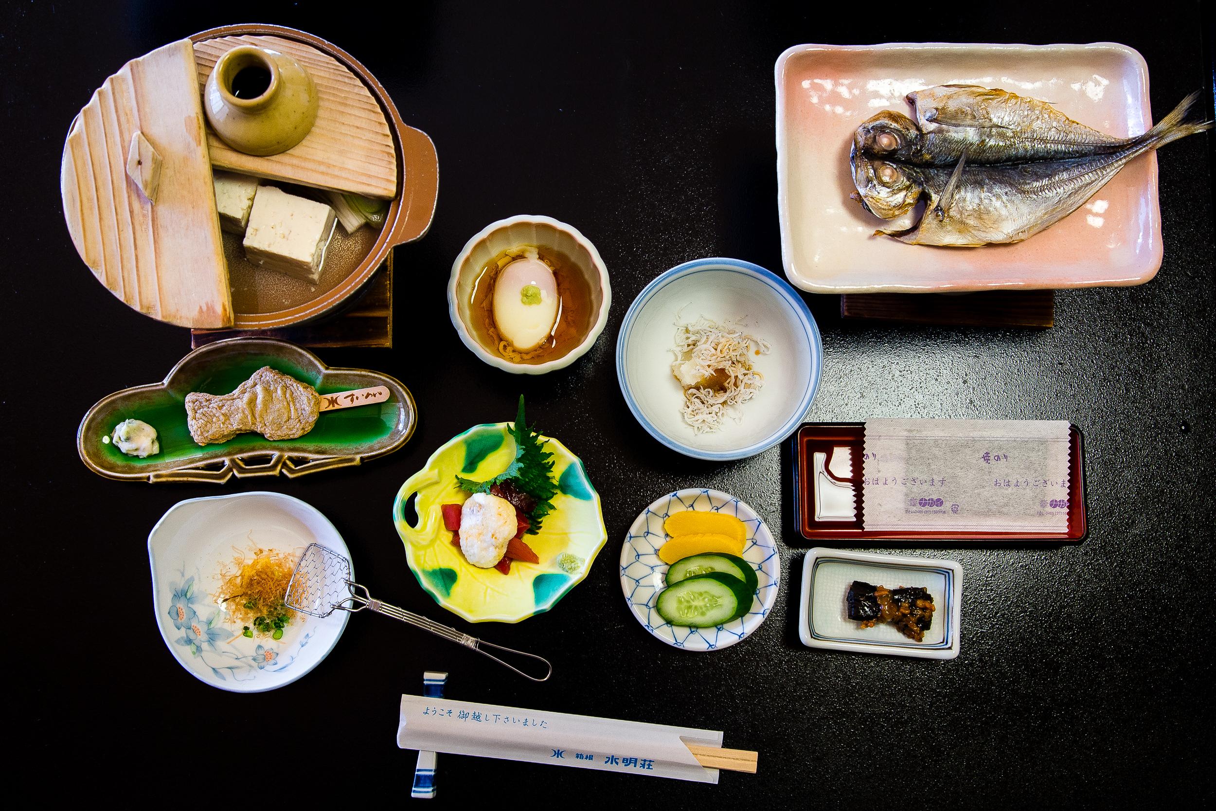 Breakfast: Tofu hot pot, fish cake, onsen egg, baby sardines, tsukemono