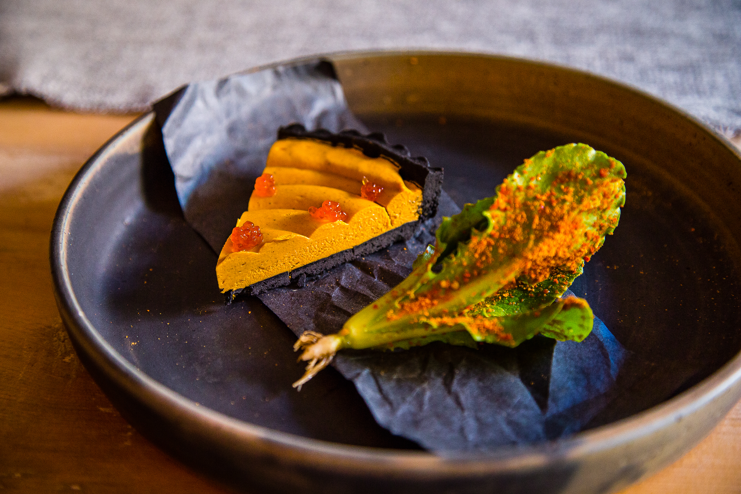Uni Pie with a Squid Ink Crust and Lettuce with Piment D'Esplette at Le Mousso