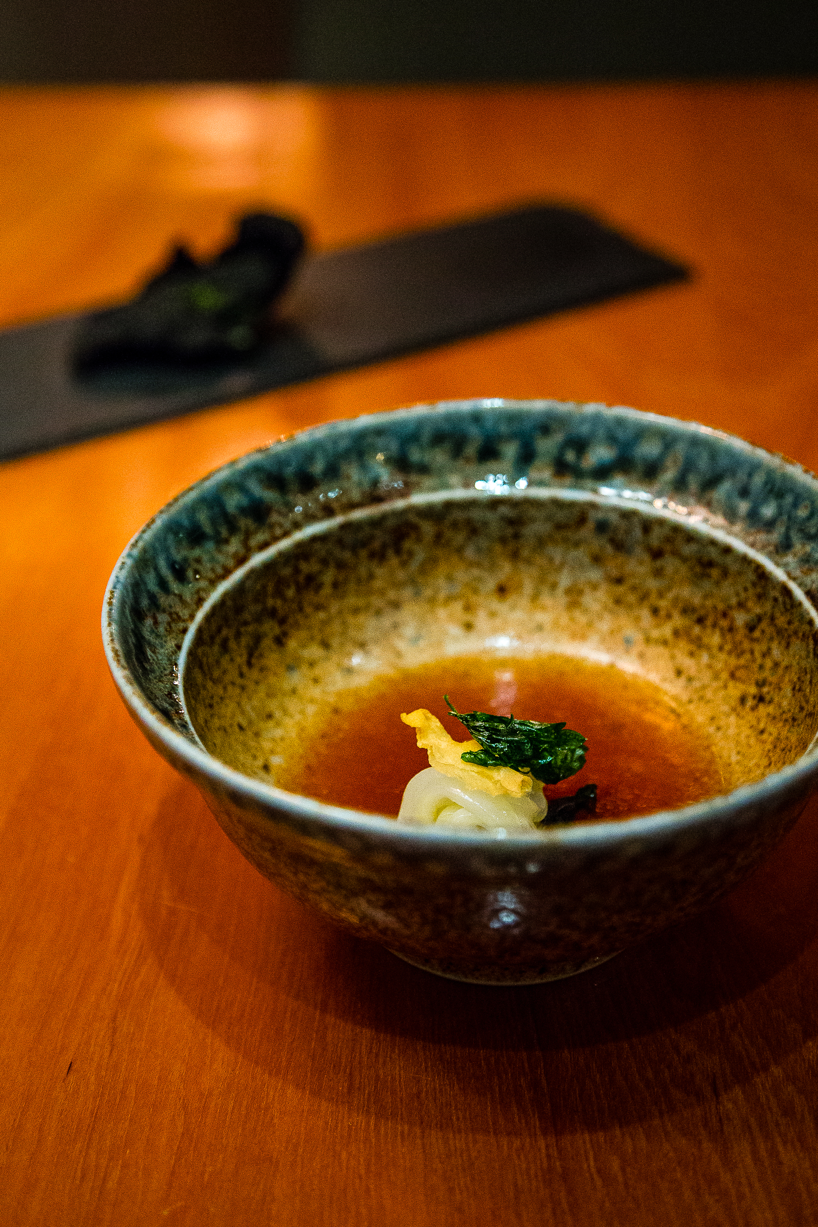 Squid Ink Rice Cracker, Seaweed Powder-Cured Squid with Potato Mousseline and a Garlic, Mushroom Consomme