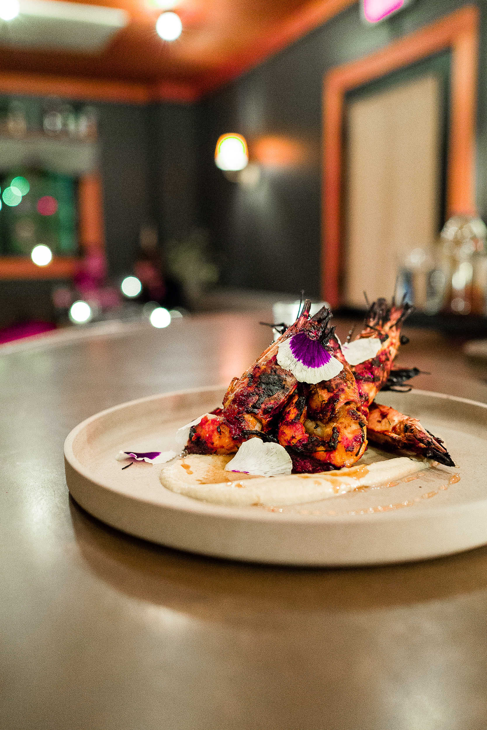 Head-on prawns with pistachio and harissa