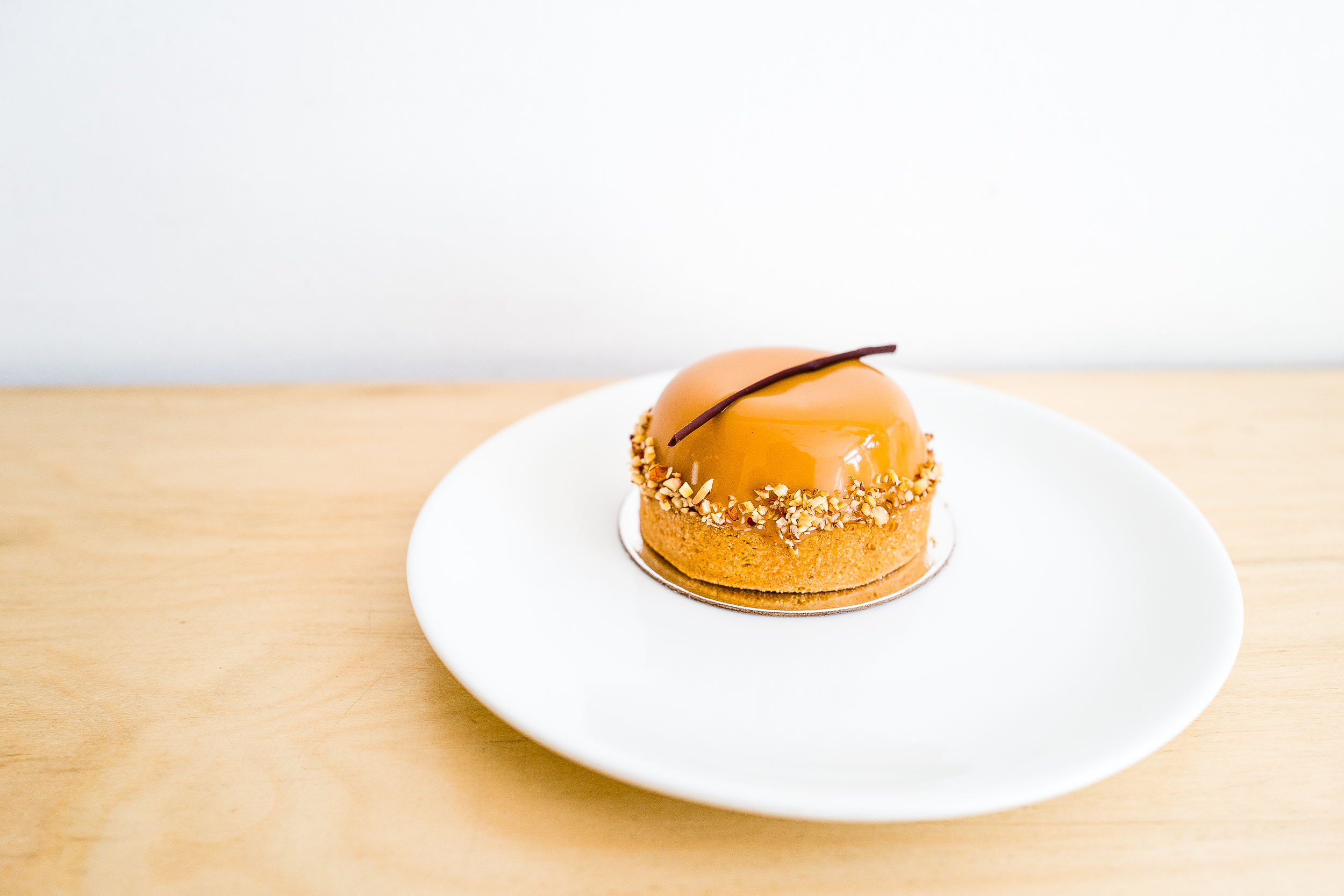 Turtle Tart: milk chocolate mousse, rum-soaked chocolate biscuit, salted caramel, and candied pecans.