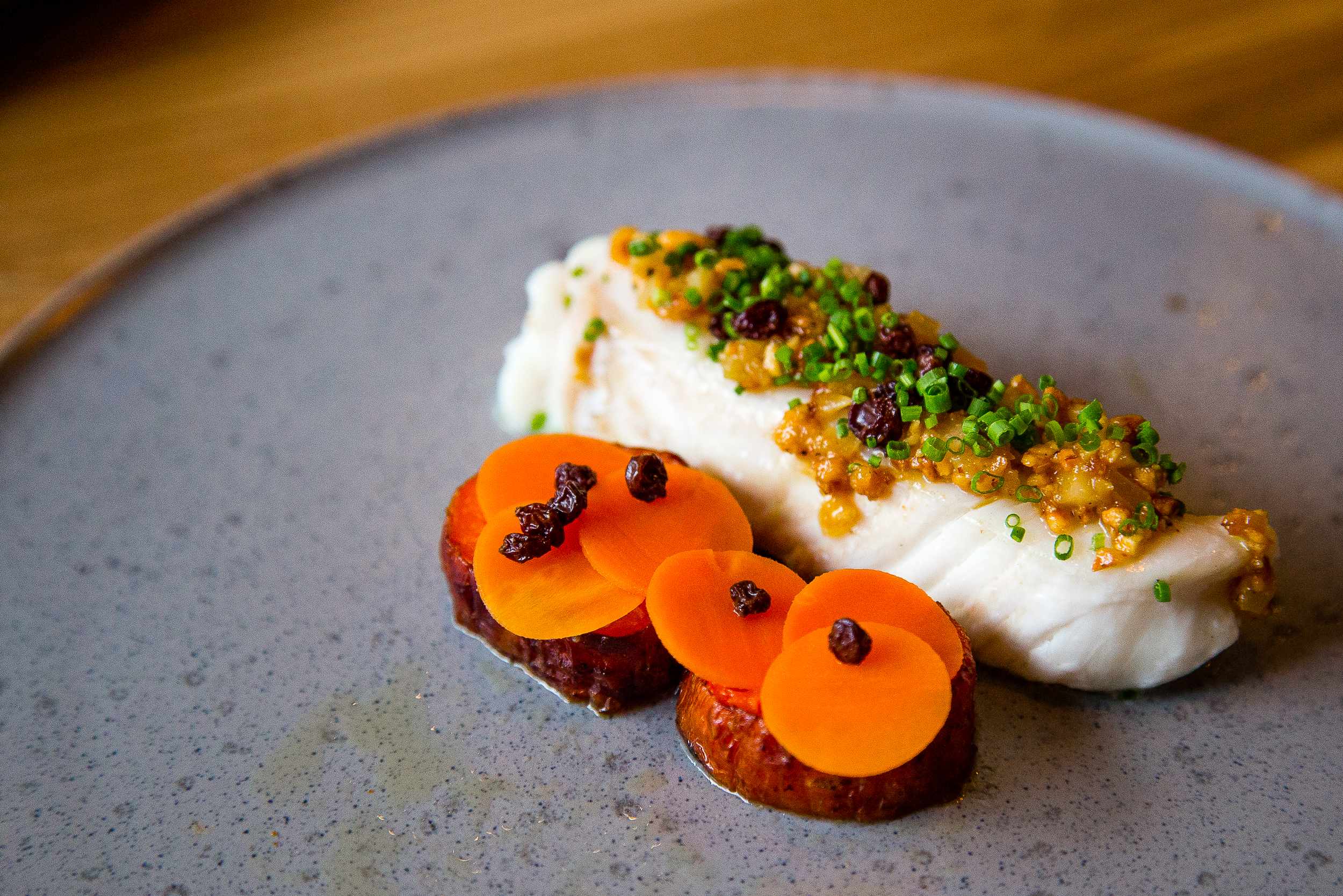 Halibut, hazelnut, corn, roasted carrot, currant raisin
