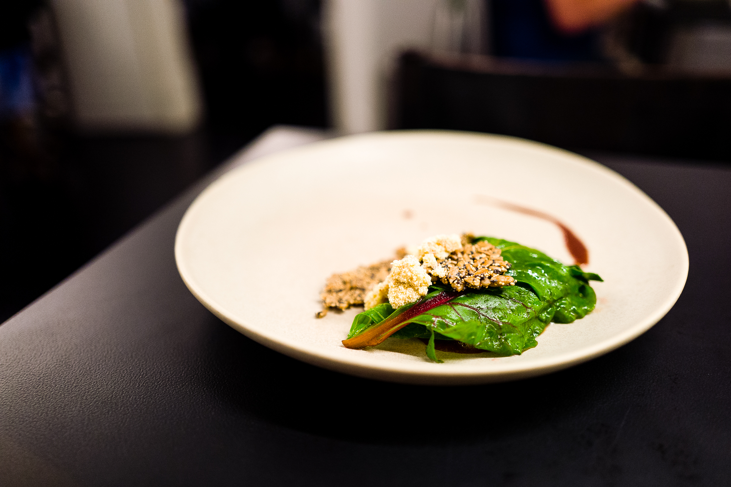 John Dory, swiss chard, John Dory roe, crunchy seeds, and a miso butter sauce.