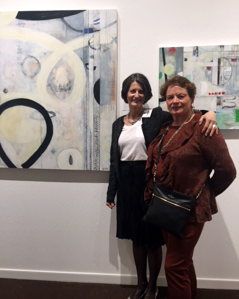 Magdalena Bogart (left) with her new collector who bought the painting to the left.