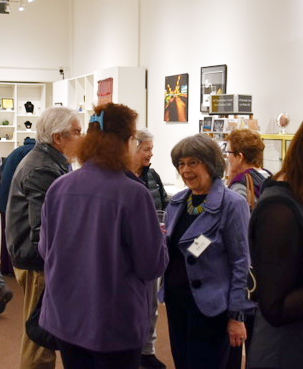 Sydell Lewis discussing her process with art lovers and friends at the opening reception