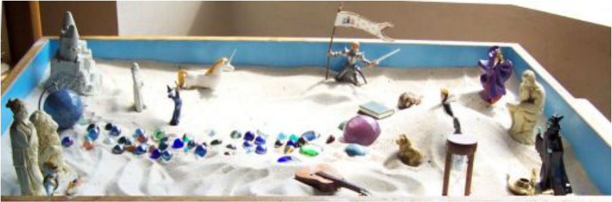 """Sandtray titled """"Recovering pieces of the lost self."""""""