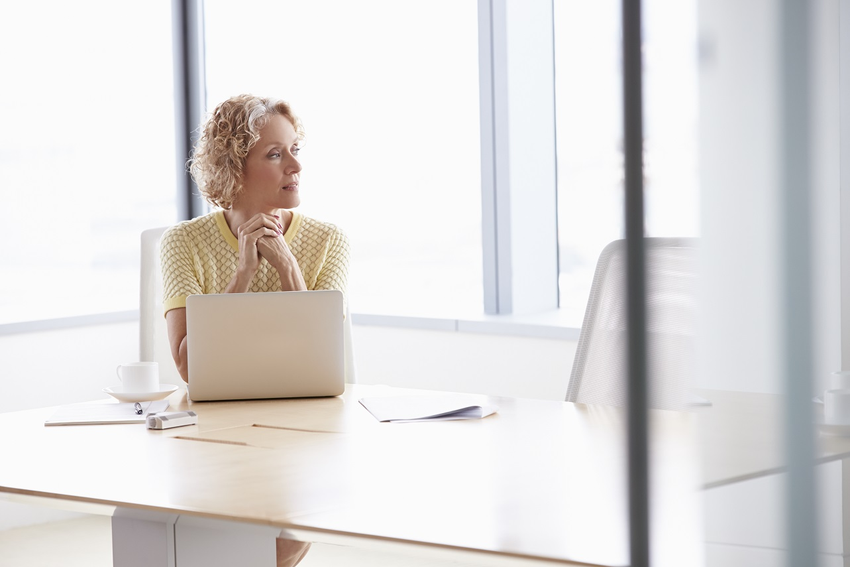 Woman on laptop thinking.jpg